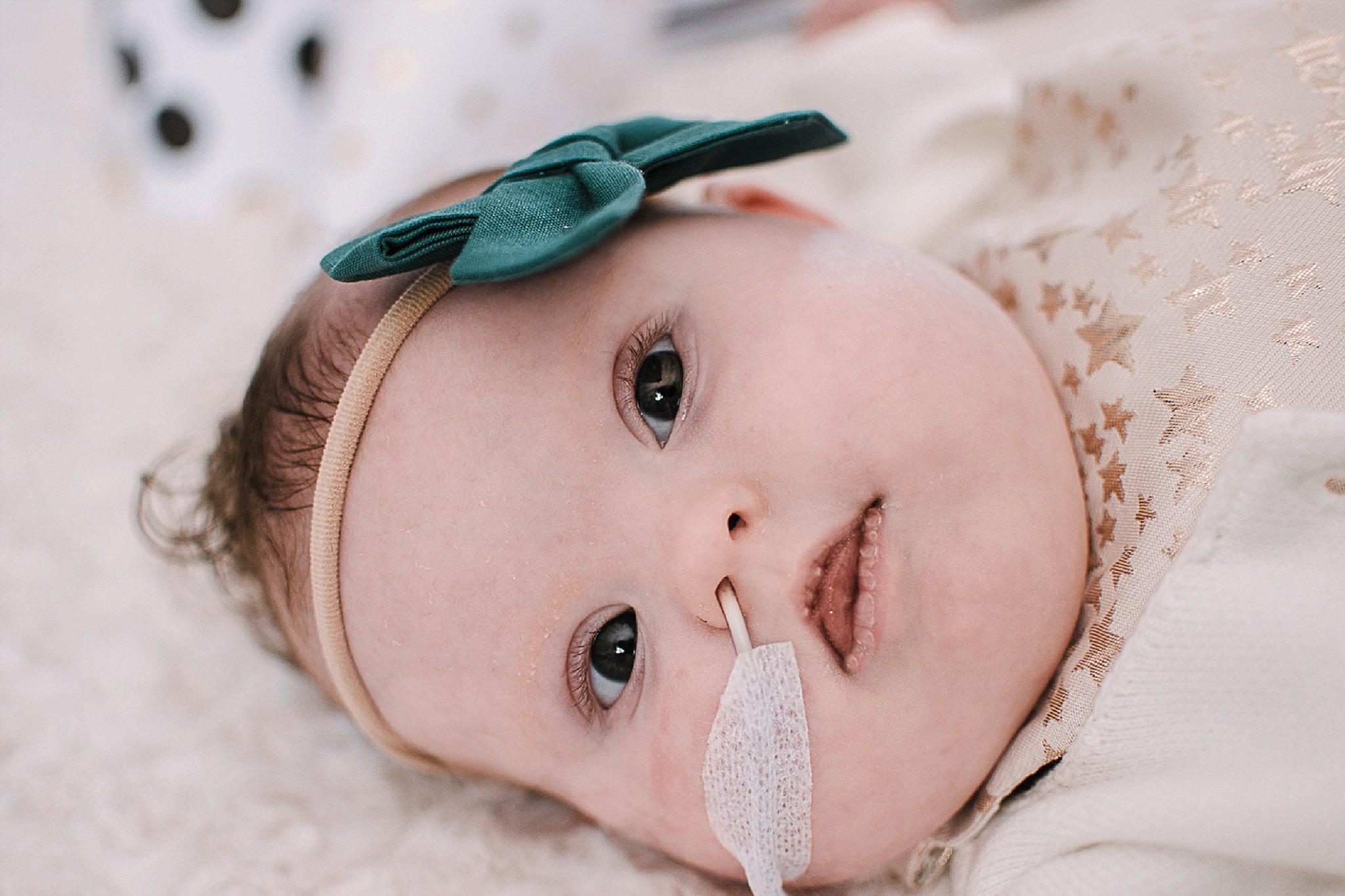 The hardest part about her being tube fed, is Reagan is growing more aware of having the tube in her nose. The last time we had to change it, she screamed for 30 minutes after. It used to be so easy to change her tube out, now it makes me cry. - Mandee Defee