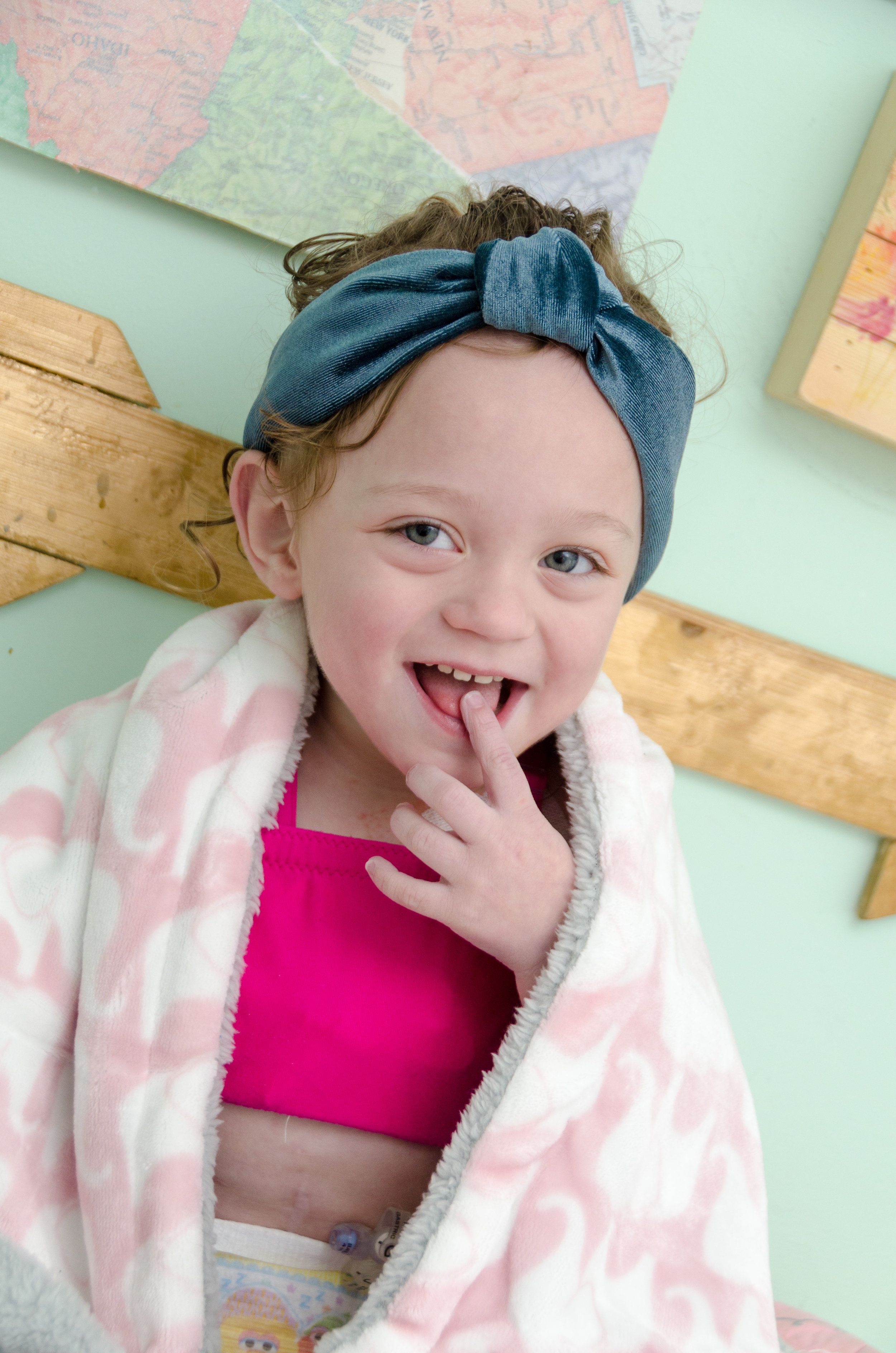 What Else is Addie Wearing? - Her headband is made by our favorite KRZA and her blanket is from Hello Snuggles which is the softest.