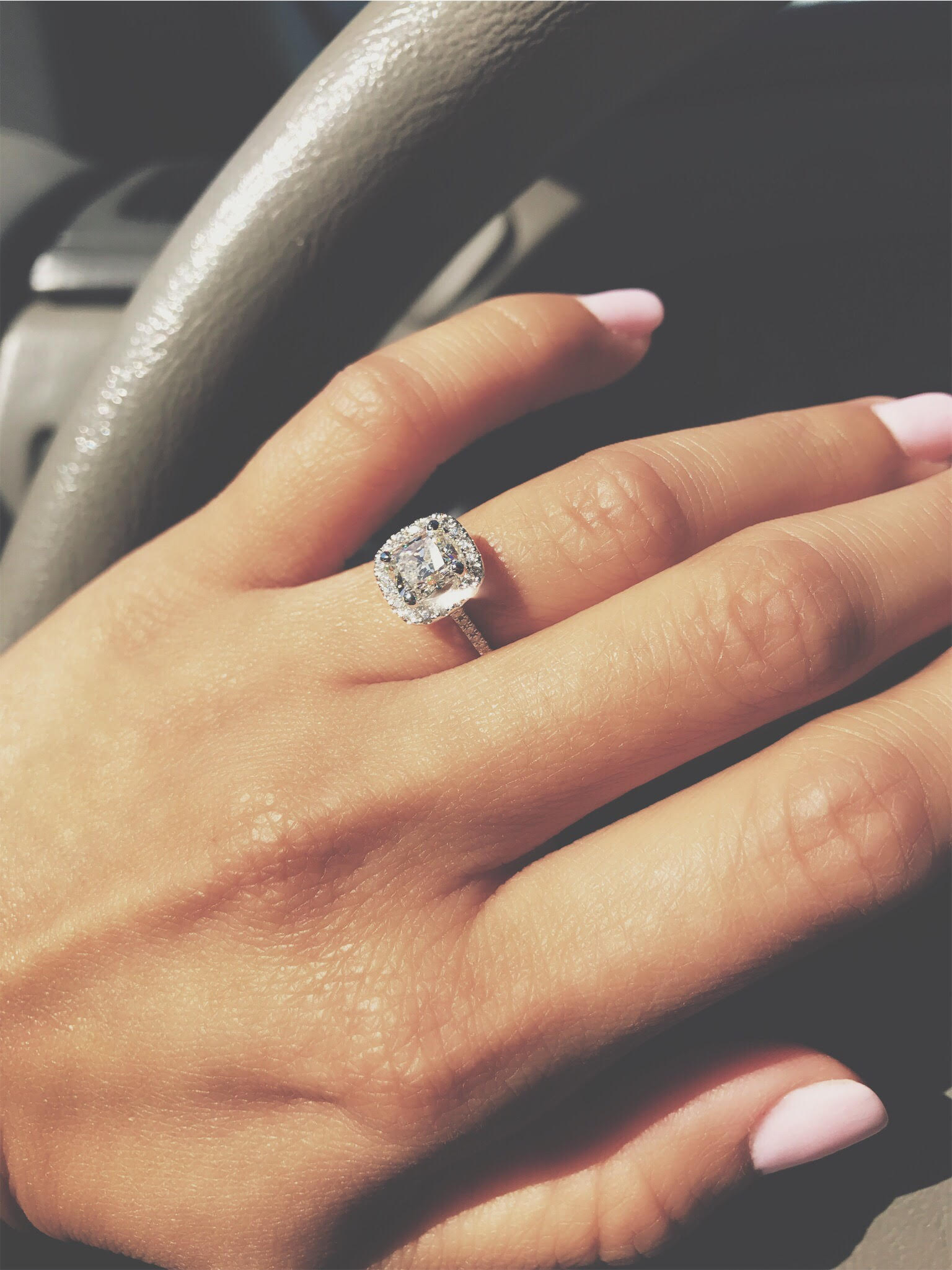 The Ring: a Radiant Cut in a Cushion Halo
