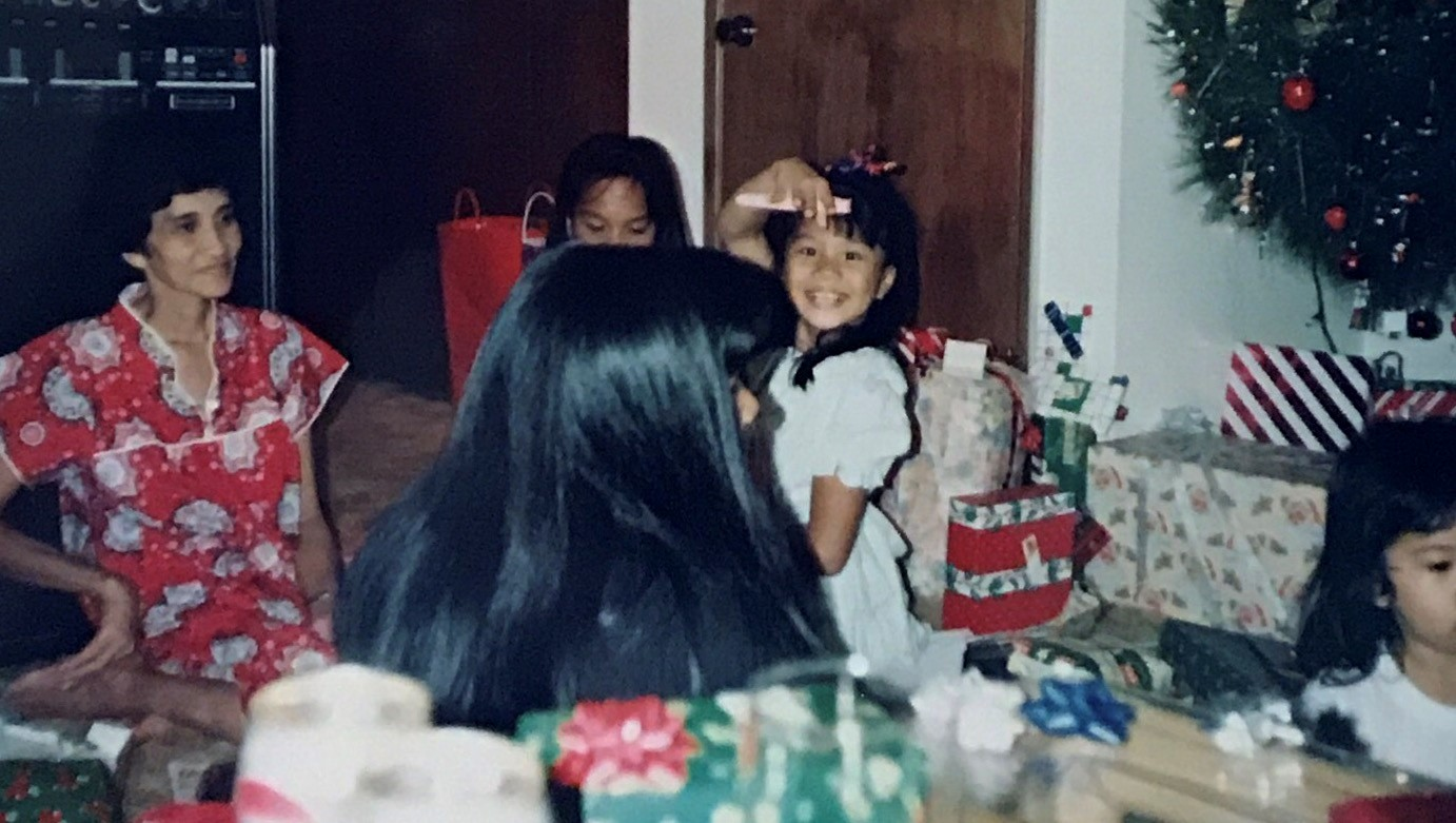 Christmas, 1992 - Holding up the pen to my very first journal while my Auntie Ruby looked on.