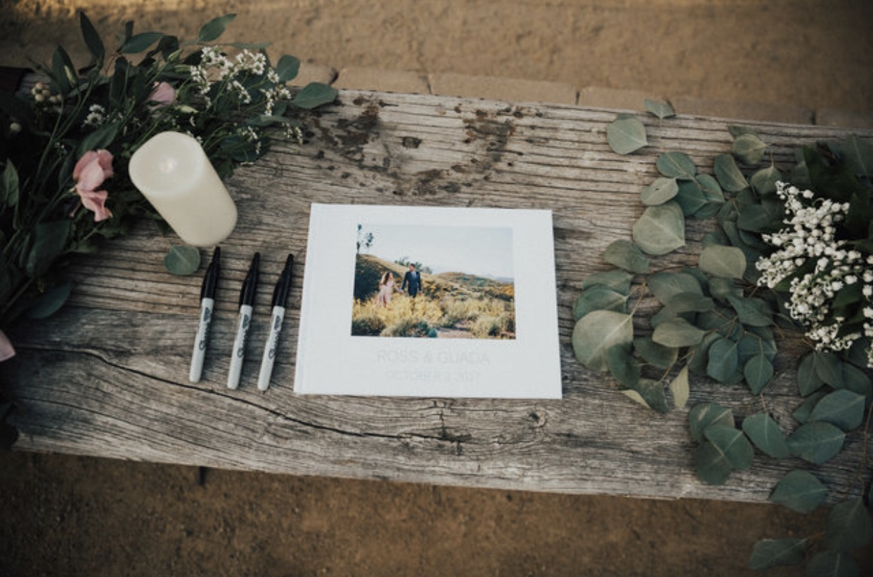 """This is an album of our Engagement photos which we also made into a guest book where our guests could leave us a little note. My favorite note is by my 10-year-old nephew, Micah. He wrote, """"Good luck with her."""" LOL."""