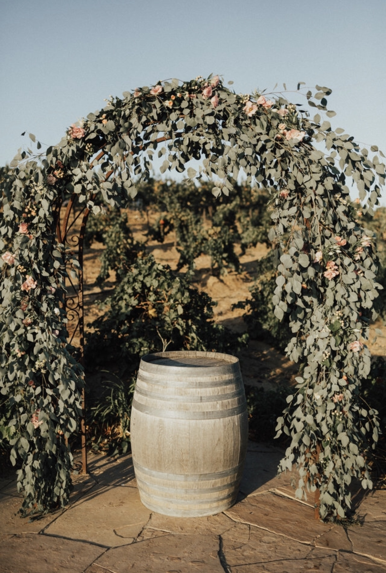 I did not want an arch made of ONLY flowers as that has always looked too over-the-top to me. So, Stephanie filled the arch with Eucalyptus and accented it with flowers here and there. This was perfect and I cried when I first saw how beautiful it looked.