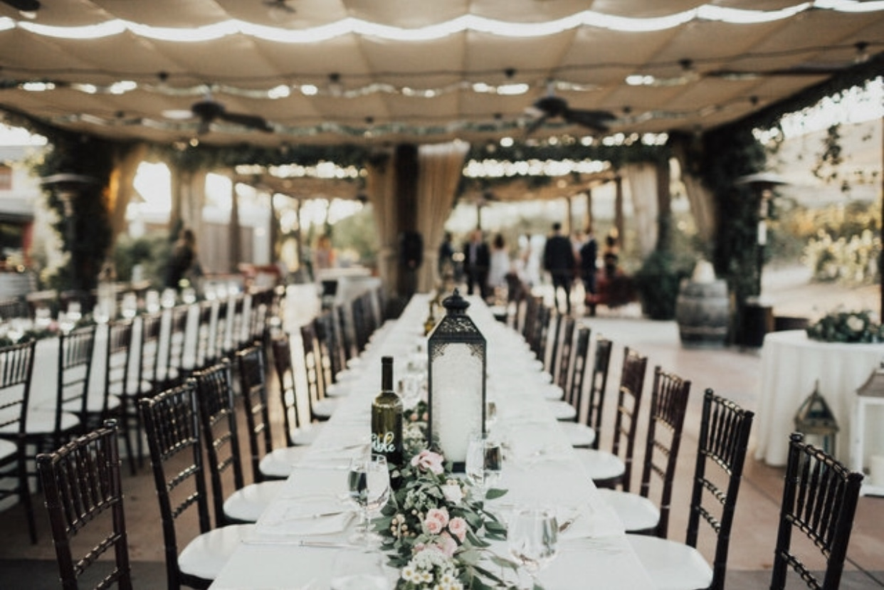"""I wanted long banquet tables for my guests, as opposed to the round ones typically found in weddings. Round tables always felt a little too """"prom-ish"""" to me. I kept envisioning long banquet tables because they are often mentioned in the Bible. Seeing this made me think of the Wedding Feast of the Lamb. It gives me good goosebumps."""