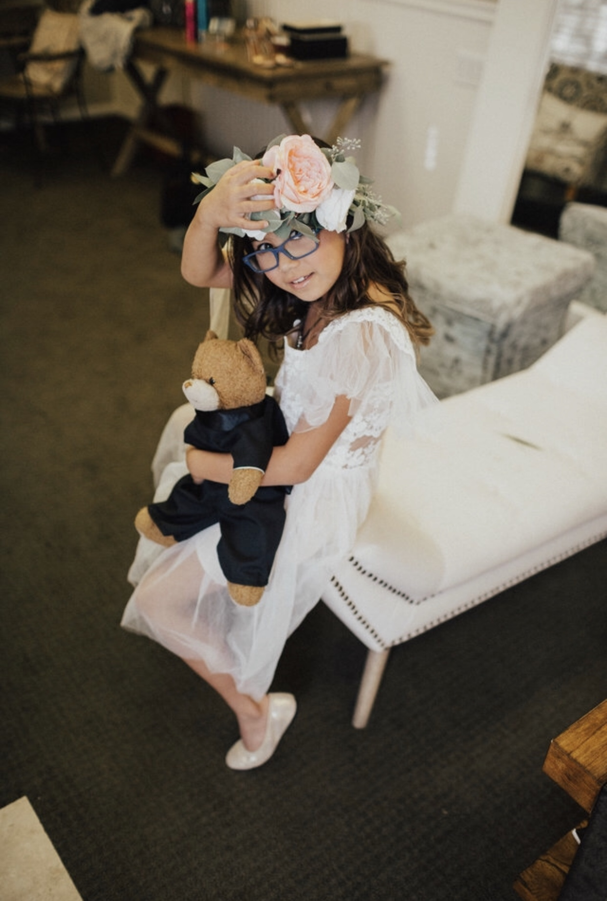 Stephanie wove those flowers in for Sophia's head crown...and Sophia made sure Bear came prepared with his own Suit.