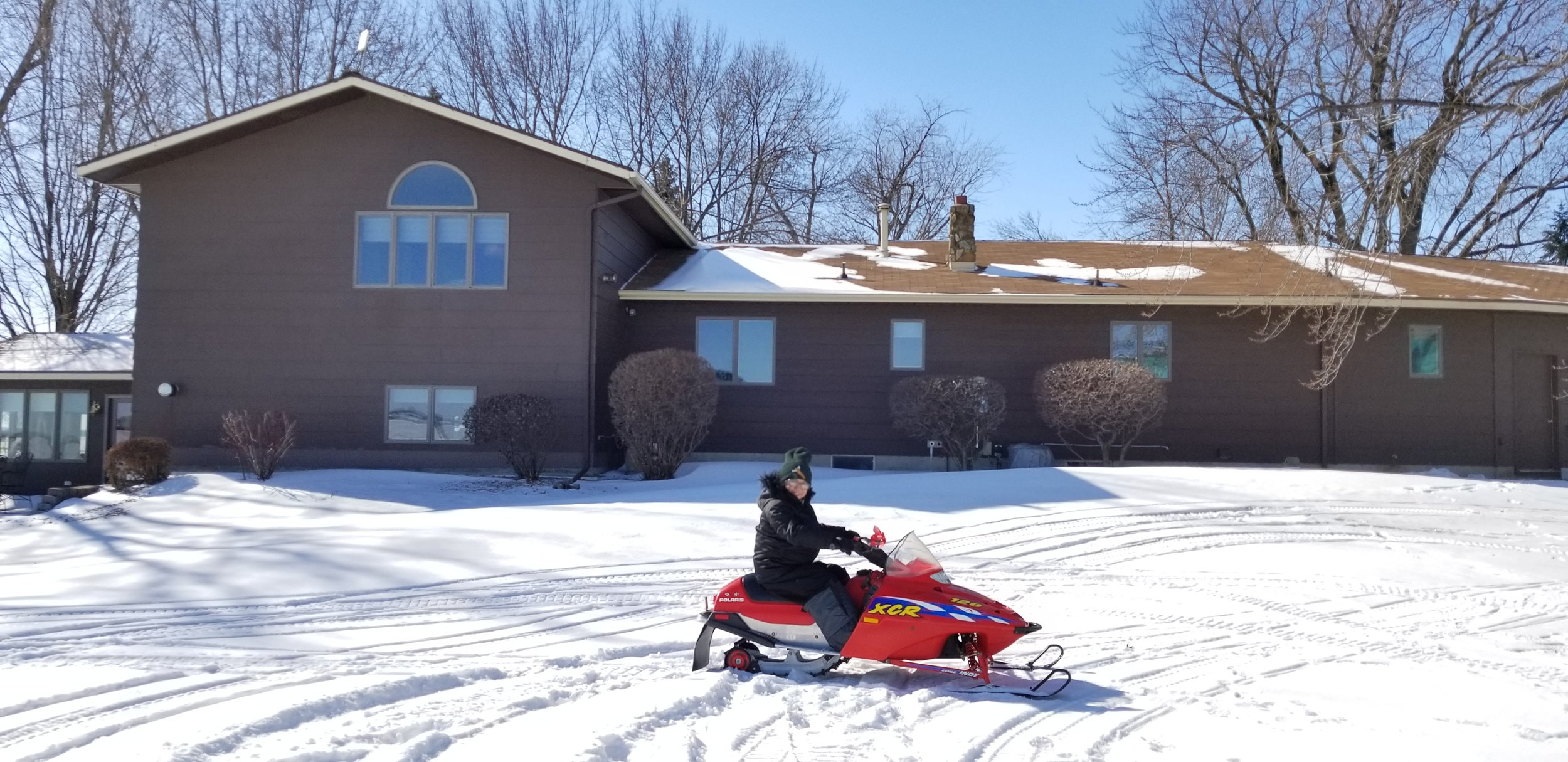 Sophia's first experience snowmobiling.