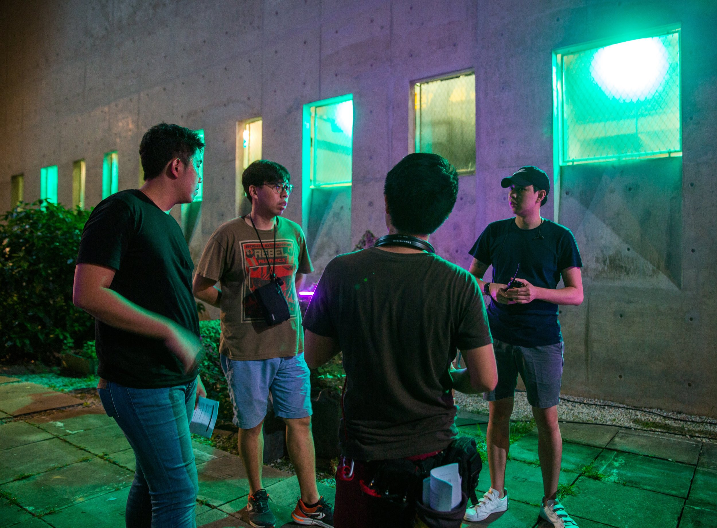 Mengchee Chiang (Director of Photography), Nicholas Lo (Director),  Roy Paulinus  (Assistant Director) and Chong Shijie (VFX advisor, CraveFX) discussing a challenging shot.
