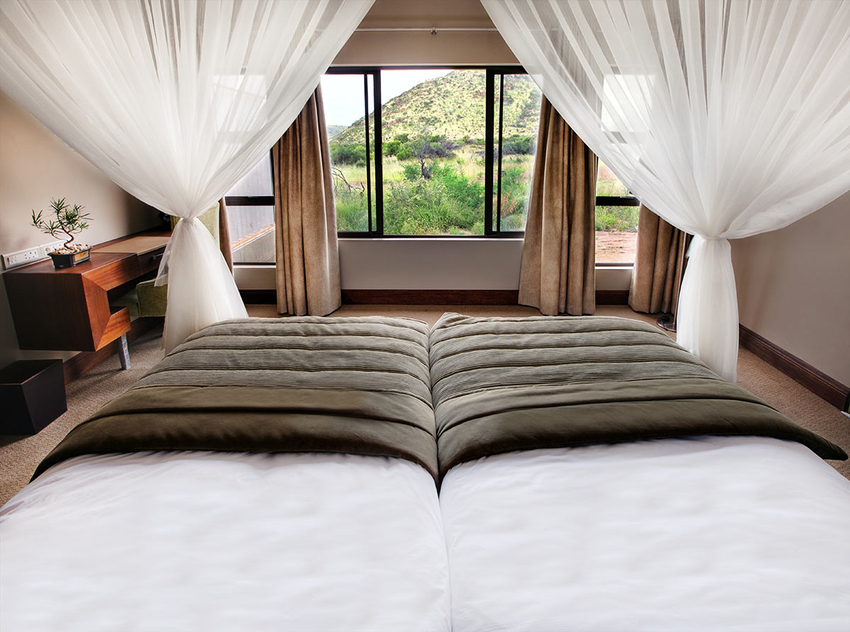Shepherds-Tree-Game-Lodge_Luxury-Suite_Bedroom.jpg