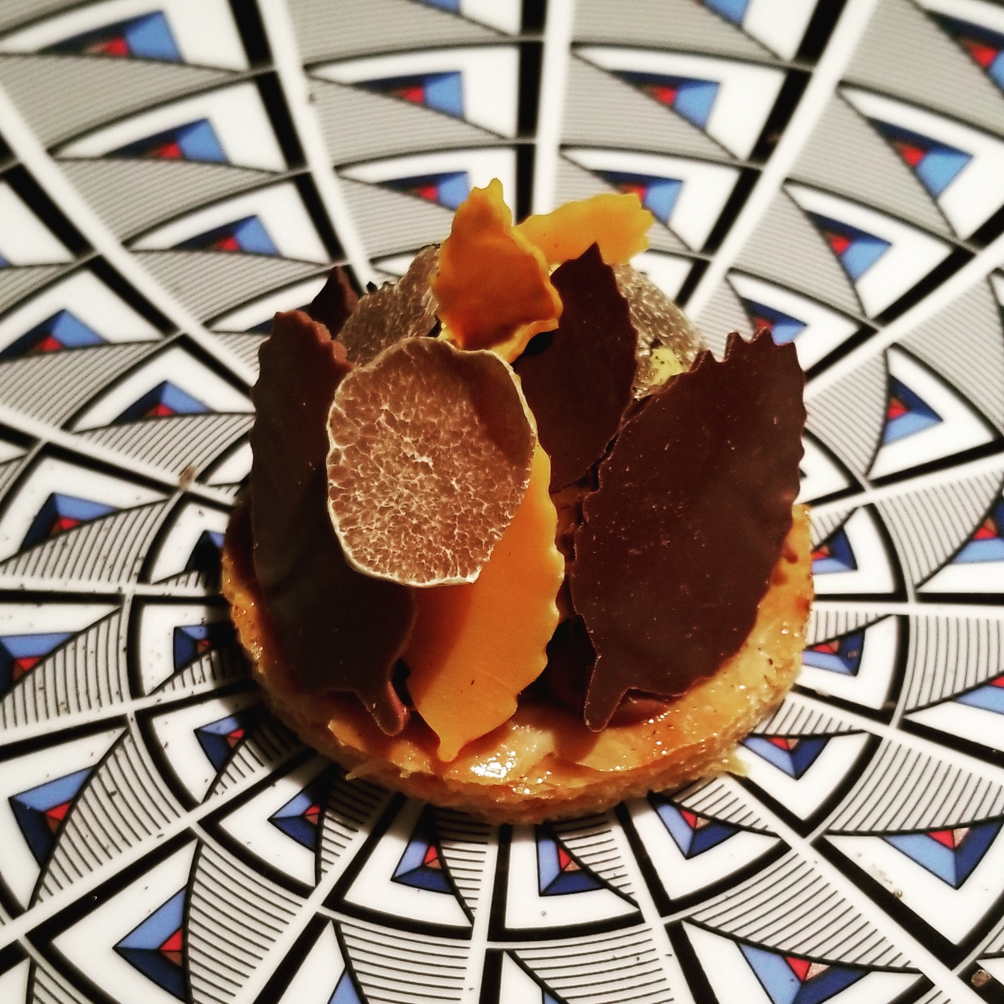 "Millefoglie di millefoglie""    Layers of pastry topped with black & white truffle, pumpkin, and leaves of chocolate."