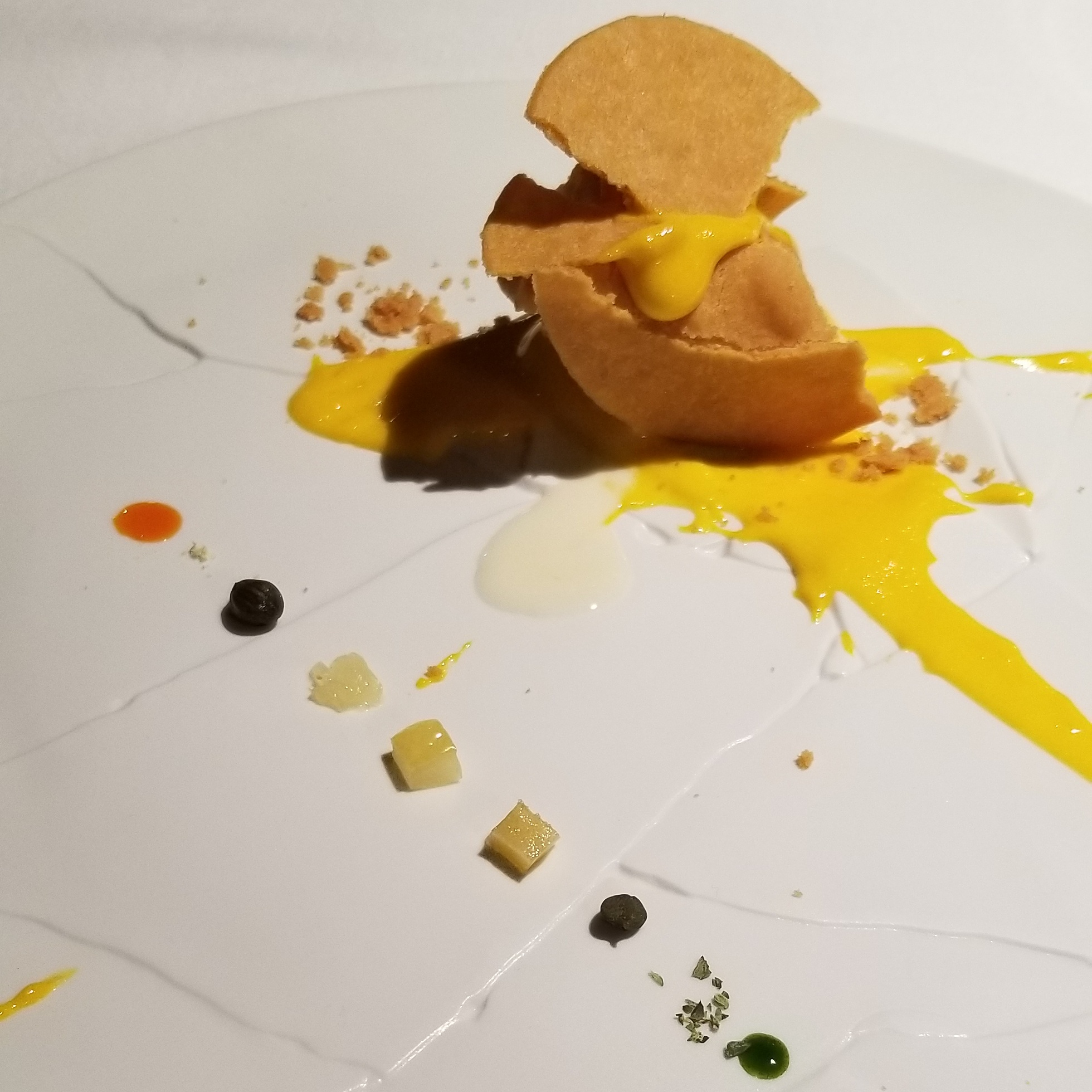 """Oops! I dropped the lemon tart""    Zabaglione, lemongrass gelato, and a cracked tart crust are accentuated by mint sauce, candied lemon, candied bergamot, capers, red chili, oregano, candied ginger, and lemon powder."