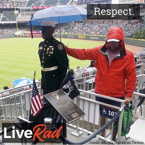 "This stirring photo was taken on Memorial Day 2018. During the third inning of the baseball game there was recognition of the POW-MIA Chair of Honor. This chair always sits empty in remembrance of the soldiers who were prisoners of war or declared missing in action. As part of the reverent ceremony, a US Marine Corps Jr ROTC student stood in the rain next to the chair. Shortly after, a fan unexpectedly stood and quietly held his umbrella to protect him from the rain. The caption of the photo posted on Twitter by the Atlanta Braves simply said, ""Respect."" #liverad #inspiringkindness #wecanalldosomething #whatwillyoudo #makeadifference #serve #giveback #compassion #sharegoodness #patriotism #respect #veterans #POW #MIA #chairofhonor"
