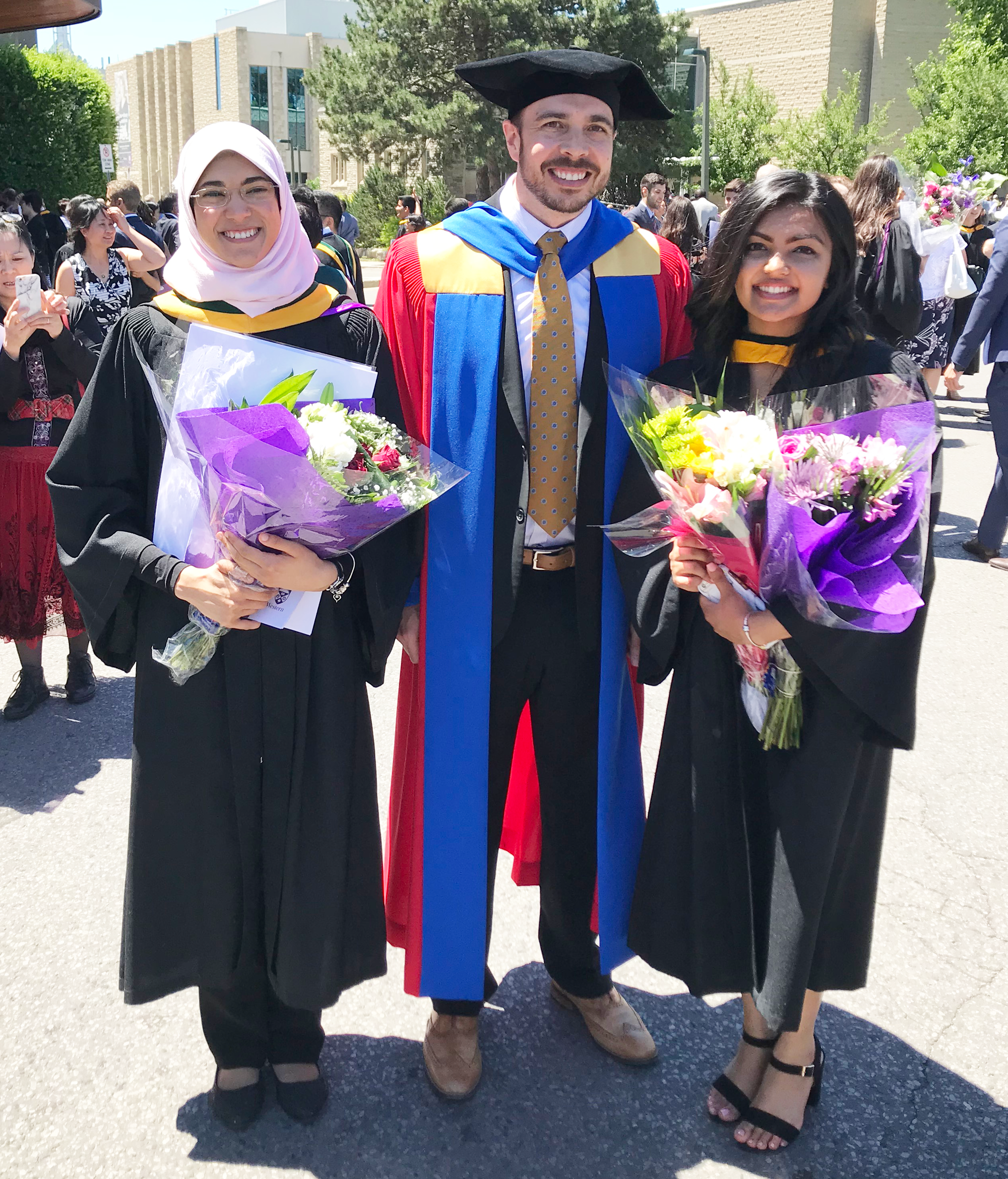 Yomna, Steve, and Maitri in their wizarding robes for convocation.