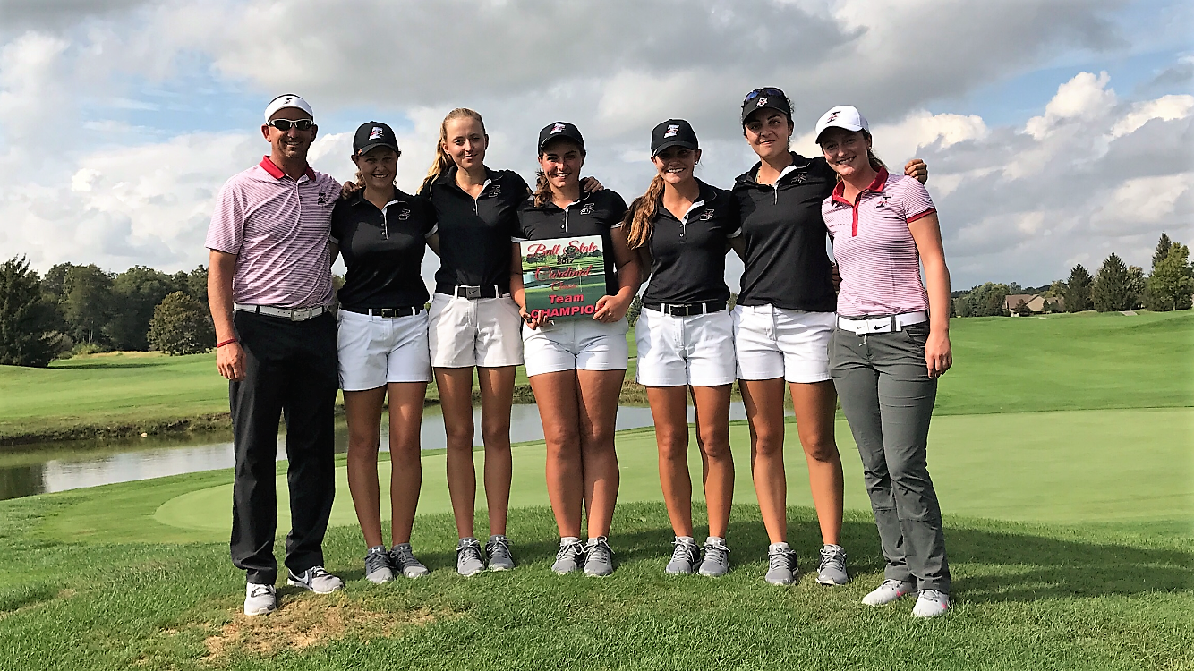 The Indy women, with coach Brent Nicoson (left), have won their first two tournaments of the season. Photo courtesy of Nicoson.