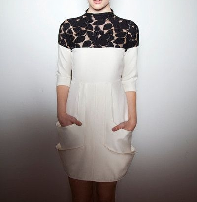 - Marie Claire Luxe DressThis exquisite sheath cocktail dress is perfect for a variety of occasions. It is constructed of a creme ponte knit fabric, a yoke of black floral lace, and double pockets.
