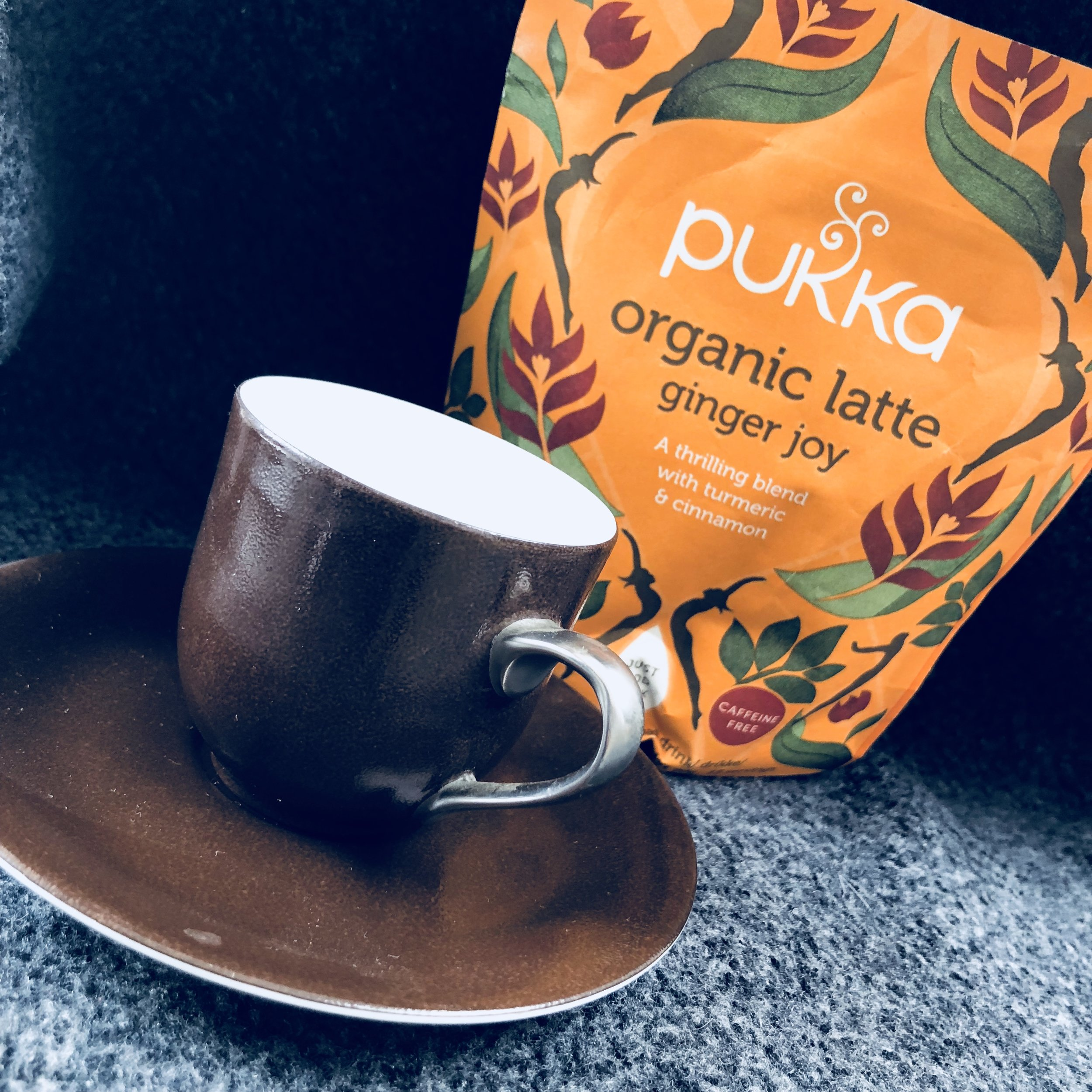 """Need an option to the 5 cups of coffee a day you're drinking? Totally bored with herbal tea?  Try the collection of four Organic Latte herbal drinks by  Pukka  that taste kinda naughty but truly aren't!  A first - or so I believe - these drinks are classified as organic and only contain ground spices, coconut milk powder (deemed the healthiest option, for now) or the chocolate substitute cacao powder.  Choose from  Ginger Joy  (my absolute fave and perfect for the autumn that is very soon about to start) - a blend of turmeric and cinnamon spices,  Turmeric Gold  (my husband's fave) with cardamom and saffron;  Majestic Matcha  green tea, all made with coconut powder; and  Cacao Maca Magic  with ashwagandha (an """"adaptogen"""" popular in Ayurvedic medicine which I take as a supplement to act as a general tonic and help the body cope with daily stress, memory (let's just blame the menopause), and to relieve pain and inflammation).  Simply mix with warm milk - preferably goat's, almond or oat milk for health not dairy (but that's your choice) - better heated in a pan than microwaved - stir in two heaped teaspoons with a tiny amount at first to avoid lumps, then stir in the rest of the milk and enjoy!  Around £6.99 for a sachet, which makes about 15-20 cups ...hunt them down and let me know what you think!"""
