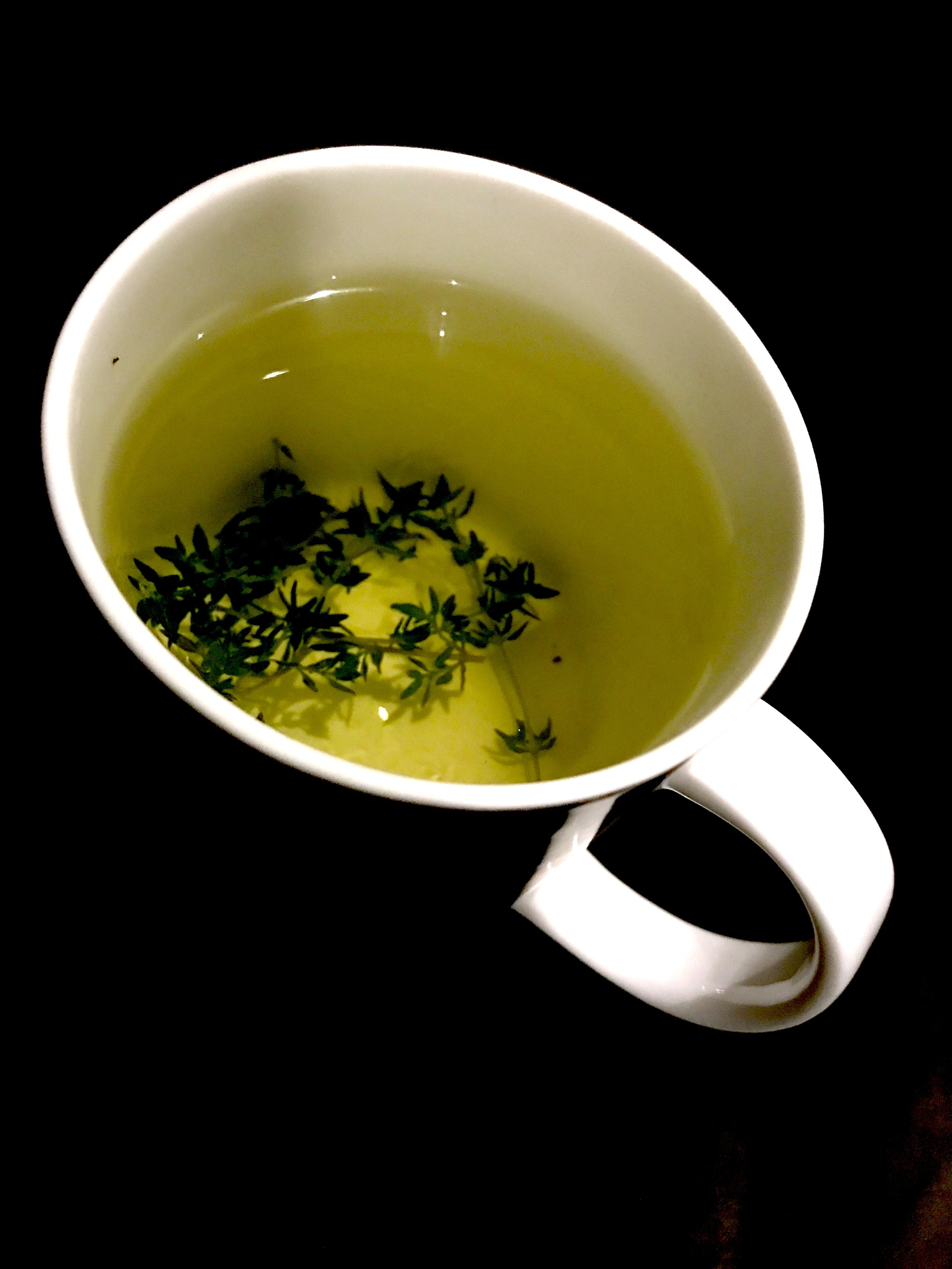 JOGBLiving cup of fresh thyme herbal tea