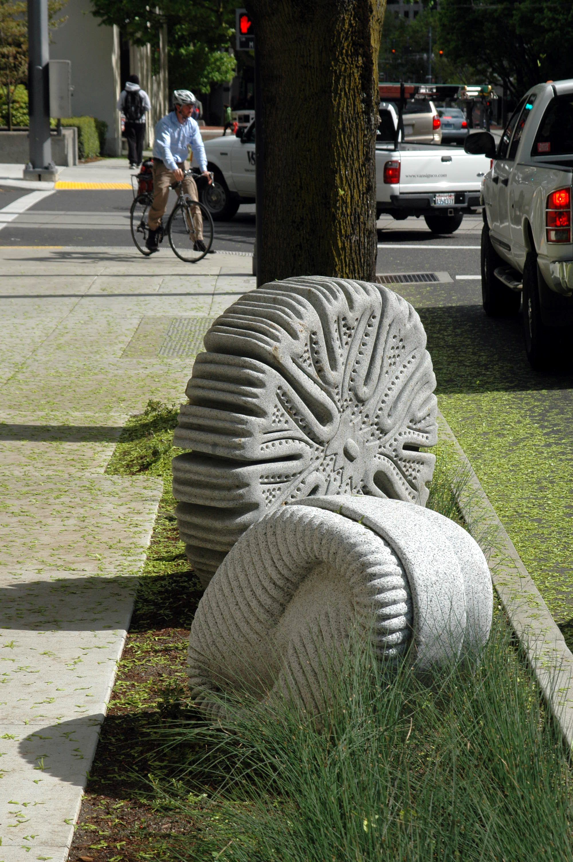 Urban Hydrology - Urban HydrologyArtist: Fernanda D'Agostino2009Carved granitePortland, ORUrban Hydrology consists of twelve outdoor sculptures along the 6th Avenue transit mall in Portland, OR, between Hall and Mill Streets. The sculptures depict oversized diatoms—single-celled algae organisms found in water—in dialogue with the filtration of urban runoff water by the bioswales surrounding the works.