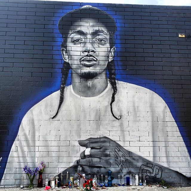 """The Marathon Continues.  Nipsey Hussle mural on Washington just east of the 10 freeway by @never1959 and @estevanoriol . Nispey is an LA legend who cared deeply for his community. Hussle wanted to focus on """"giving solutions and inspiration"""" to young black men like him.He denounced gun violence through his music, influence and community work.He spoke openly about his experiences with gang culture.He not only funded improvements to neighborhood schools but also spent time with students and participated on panels about growing up in the area and the influence of gang culture. Hussle started a co-workingenvironment which he named Vector 90.From his own experience, he saw the Crenshaw area as being under served and that young people would benefit from communal workspaces. He was killed the day before he was set to meet with LA City Officials on big ideas he had for his community. The marathon continues. . . 🌍 Find it on the map! --  MuralMapLA.com . . #muralmapla #mural #muralart #urbanwalls #urbanart #streetart #artist #art_spotlight #paintthechange #paint #graffiti #streetarteverywhere #streets #losangeles #streetsofla #neighborhood #community #publicspace #publicart #artsforla #beautifyearth #worldtour #artaroundtheworld #publicspace #losangeles #lastreetart #travel #getoutside #wanderlust"""