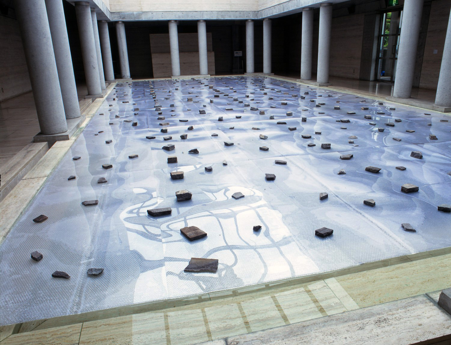 Law of Situation , 1971/1995 状況律 ( Jōkyōritsu ) Stones, plastic boards, bubble wrap, water Dimensions unknown Installation view,  Matter and Perception 1970: Mono-ha and the Search for Fundamentals , Kitakyushu Municipal Museum of Art, Kitakyushu, 1995 Photo: Tsuyoshi Satoh