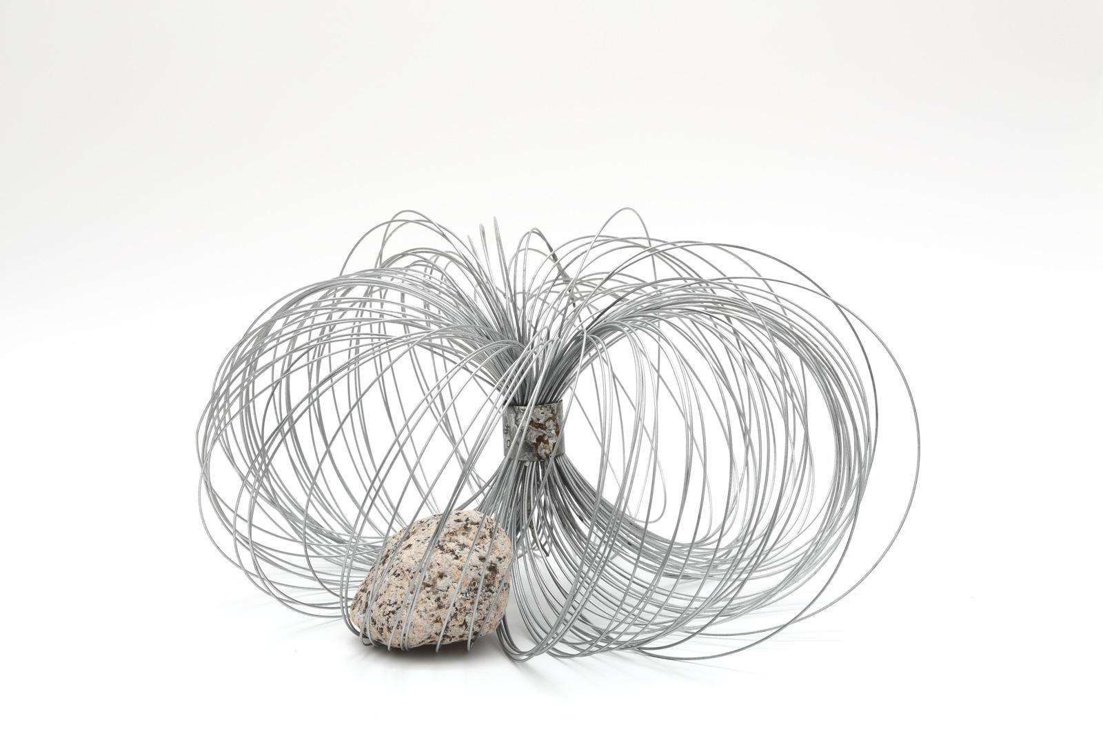 Qualities of Circulating Space , 2010 周界性 ( Shūkaisei ) Metal wire, rock 6 7/8 x 13 inches diameter  17.5 x 33 centimeters