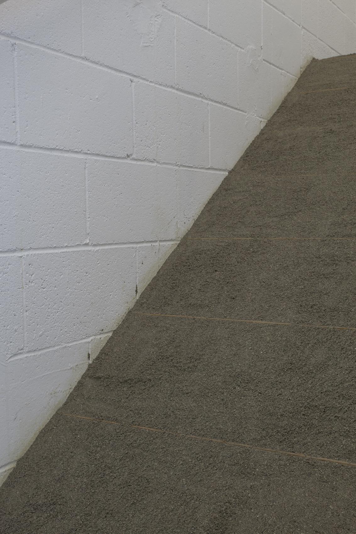 Infinite Situation II (steps) , 1970 無限状況 II (階段)( M  ugen Jōkyō II [Kaidan])  Sand, stairs Dimensions variable Installation view, Requiem for the Sun: The Art of Mono-ha at Blum & Poe, Los Angeles, 2012 Courtesy Blum & Poe, Los Angeles / New York / Tokyo