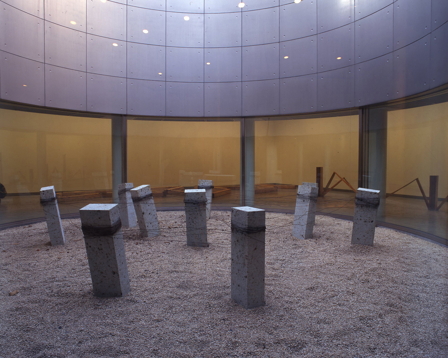 Placement of Condition , 1973/1997 状況置 ( Jōkyōchi ) Oya stone, wire Dimensions variable Installation view,  Kishio Suga , Hiroshima City Museum of Modern Art, 1997 Courtesy Hiroshima City Museum of Modern Art