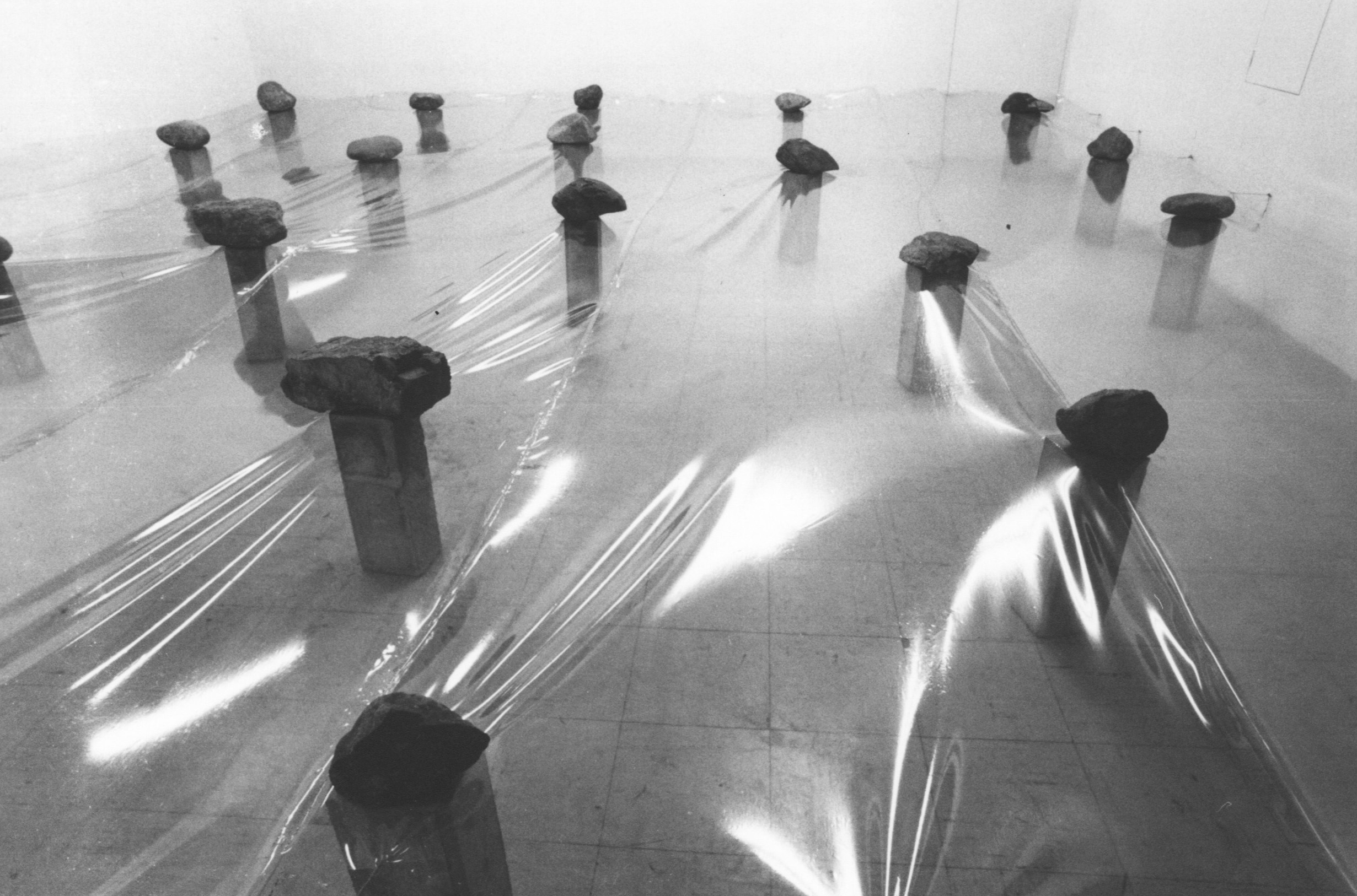 Law of Multitude , 1975 多分律 ( Tabunritsu ) Plastic sheet, stone, concrete Dimensions variable Installation view, Maki Gallery, Tokyo, 1975  Photo: Kishio Suga
