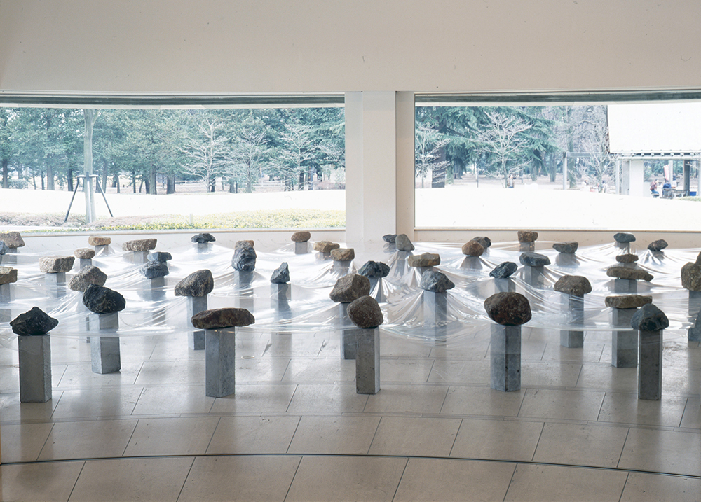 Law of Multitude , 1975/1993 多分律 ( Tabunritsu ) Plastic sheet, stone, concrete Dimensions variable Installation view,  Avanguardie giapponesi degli anni 70 , Setagaya Art Museum, Tokyo, 1993 Photo: Tsuyoshi Satoh