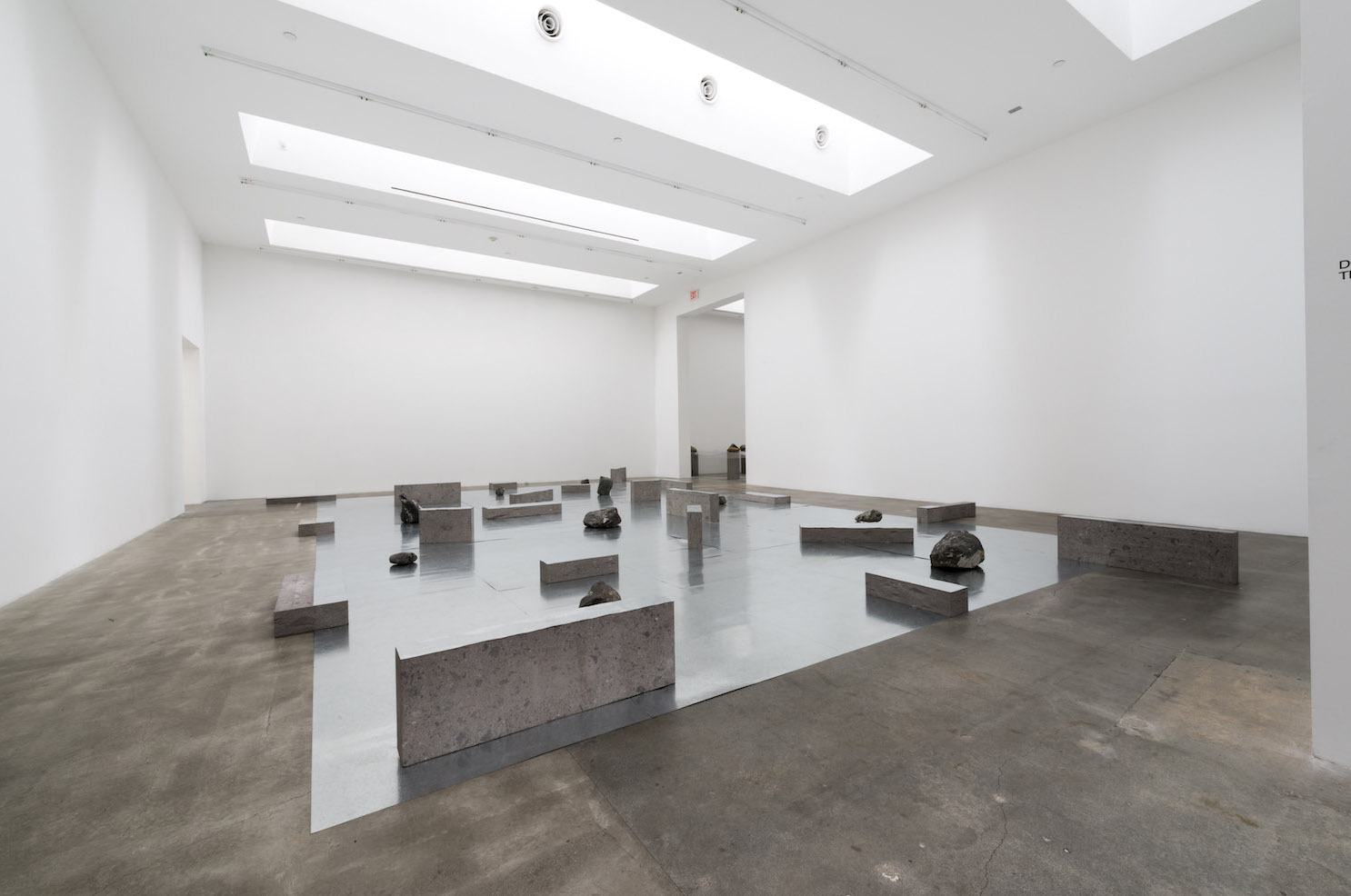 Gap of the Entrance to the Space , 1979/2012 界入差 ( Kainyūsa ) Zinc plates, stones 11 7/8 x 268 1/4 x 296 1/4 inches overall Installation view, Blum & Poe, Los Angeles, 2012 Photo: Joshua White/JWPictures.com Courtesy Blum & Poe, Los Angeles / New York / Tokyo