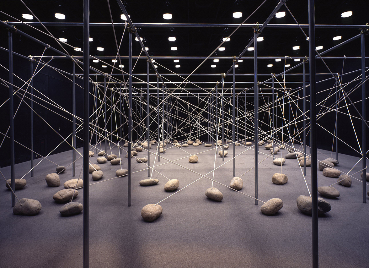 Law of Peripheral Units , 1997 周位律 ( Shūiritsu ) Steel pipes, stone, rope Dimensions variable Installation view,  Kishio Suga ,Hiroshima City Museum of Contemporary Art, Hiroshima, 1997 Courtesy Hiroshima City Museum of Contemporary Art