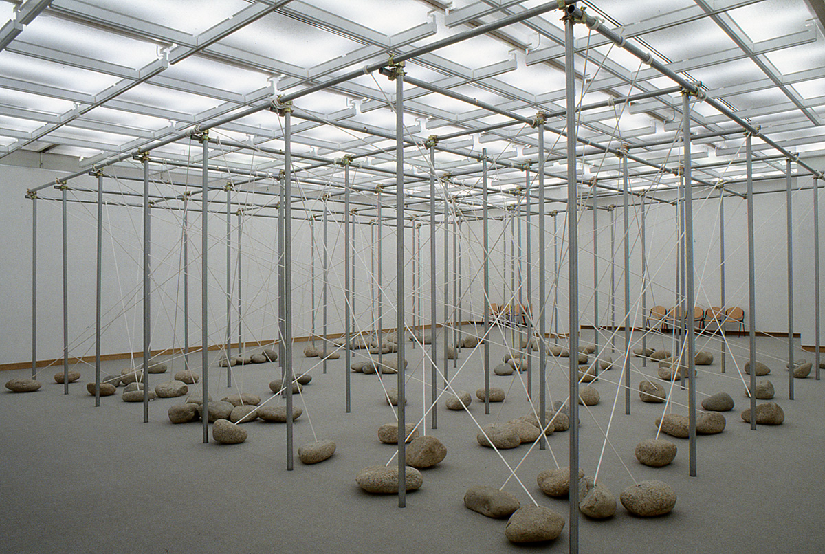 Law of Peripheral Units , 1997/1998 周位律 ( Shūiritsu ) Steel pipes, stone, rope Dimensions variable Installation view,  Kishio Suga , Chiba City Museum of Art, Chiba, 1998 Courtesy Chiba City Museum of Art