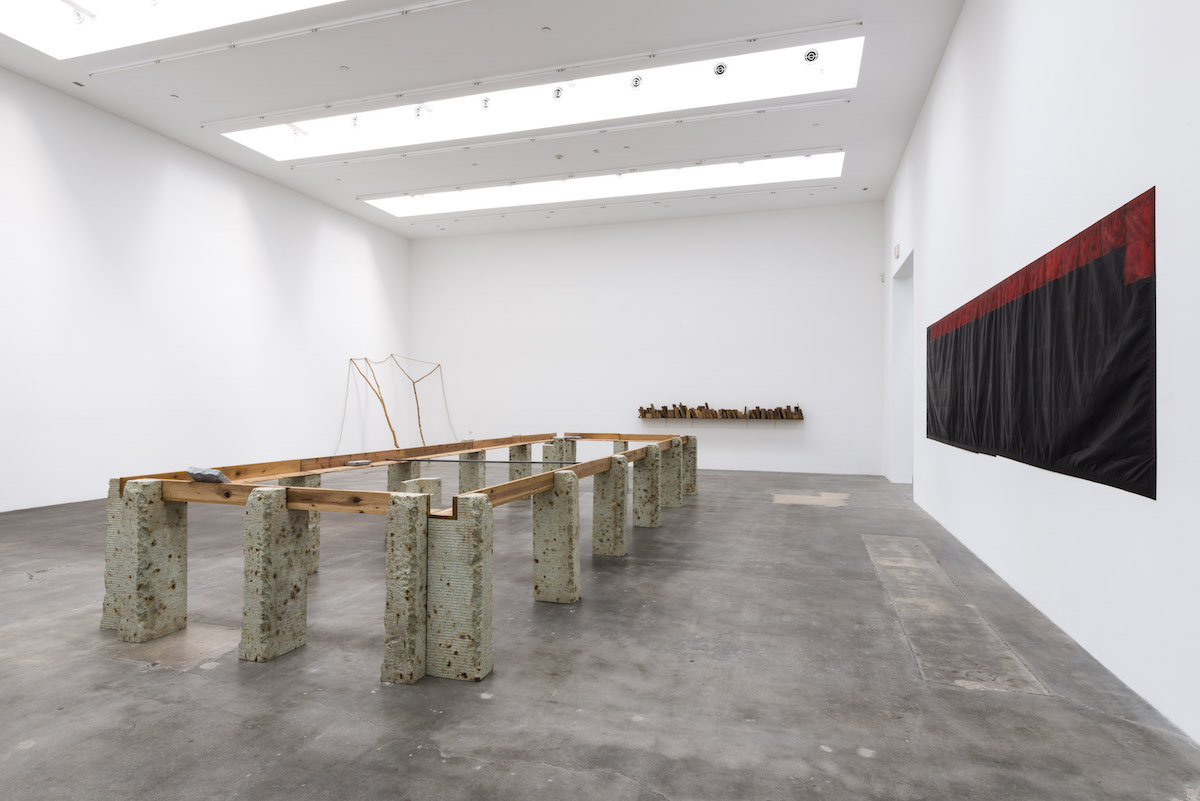 Supported Surrounding , 1987 縁辺仕帯 ( Enpen Shitai ) Wood planks, stone, aluminum 41 3/8 x 103 3/4 x 305 1/2 inches overall Installation view, Blum & Poe, Los Angeles, 2012 Photo: Joshua White/JWPictures.com Courtesy Blum & Poe, Los Angeles / New York / Tokyo