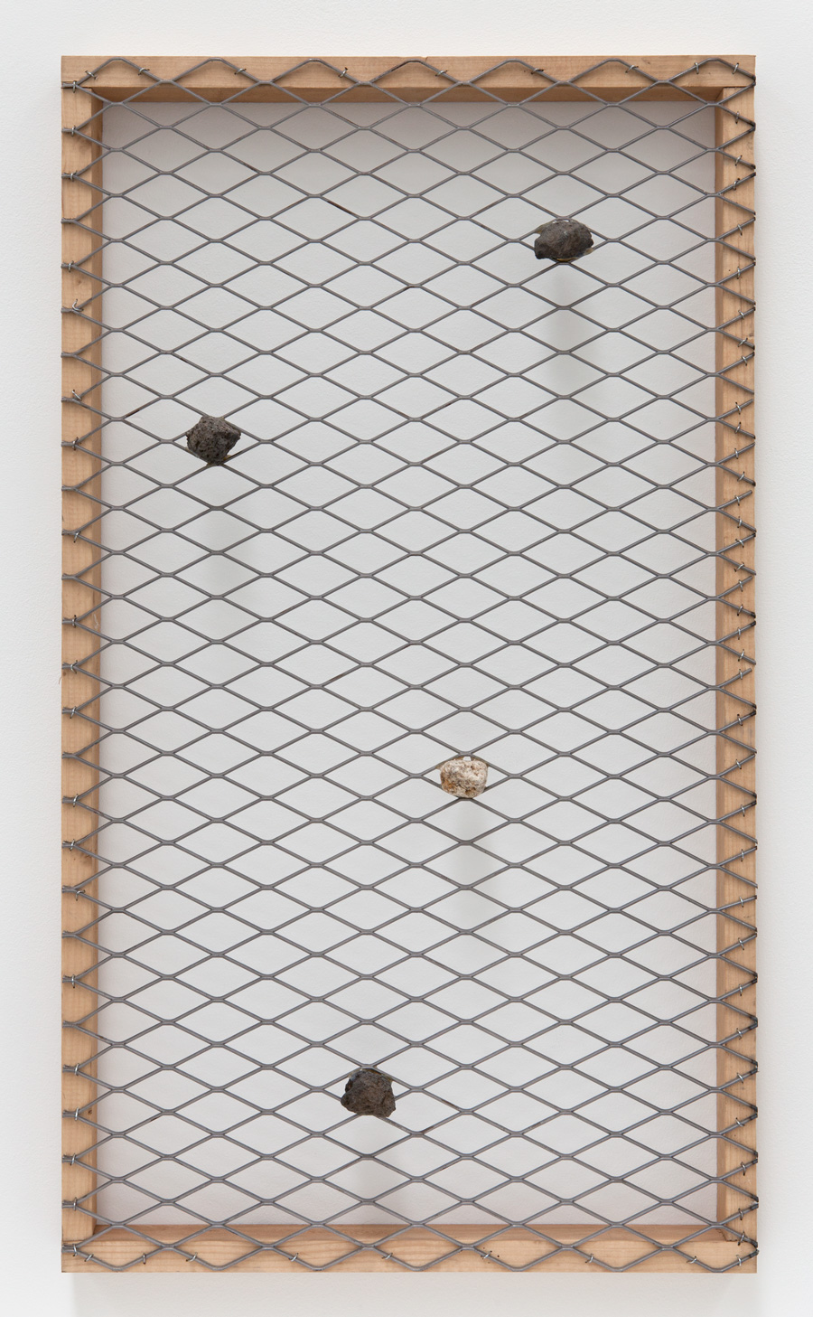 Hidden and Connected in Space , 2012 潜連空 ( Senrenkū ) Stone, wood, wire mesh 36 7/8 x 21 x 3 1/2 inches 93.5 x 53.5 x 9 cm