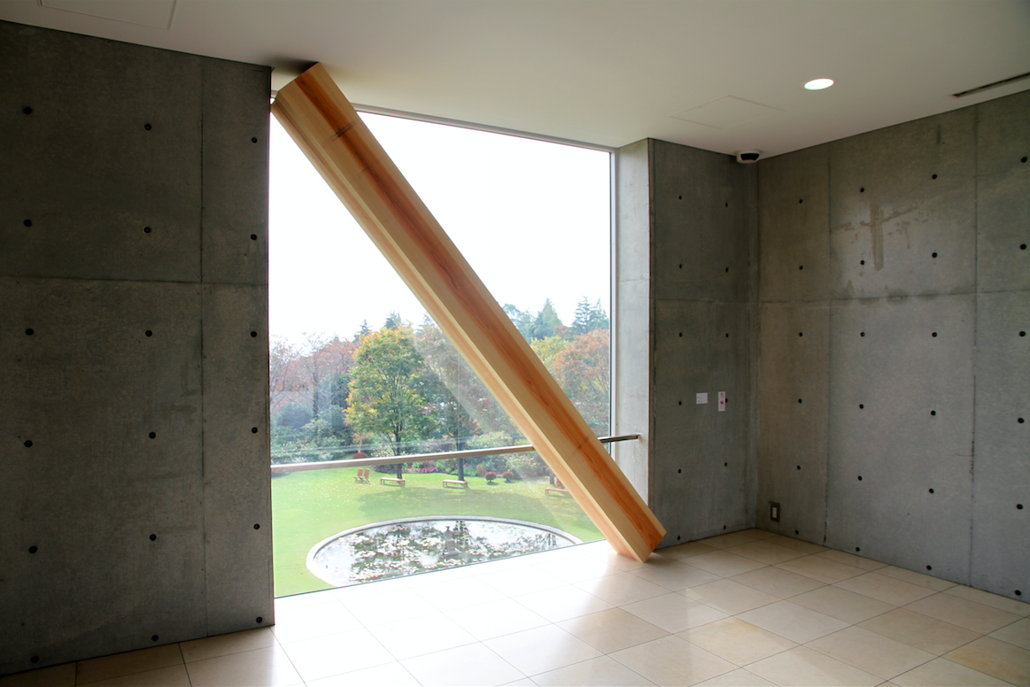 Kishio Suga,  Infinite Situation I (Window),  1970/2014. Douglas fir, window and landscape, 264.5 x 234 x 52.5 cm. Installation view at Vangi Sculpture Garden Museum, Shizuoka, 2014. Photo by Tsuyoshi Satoh
