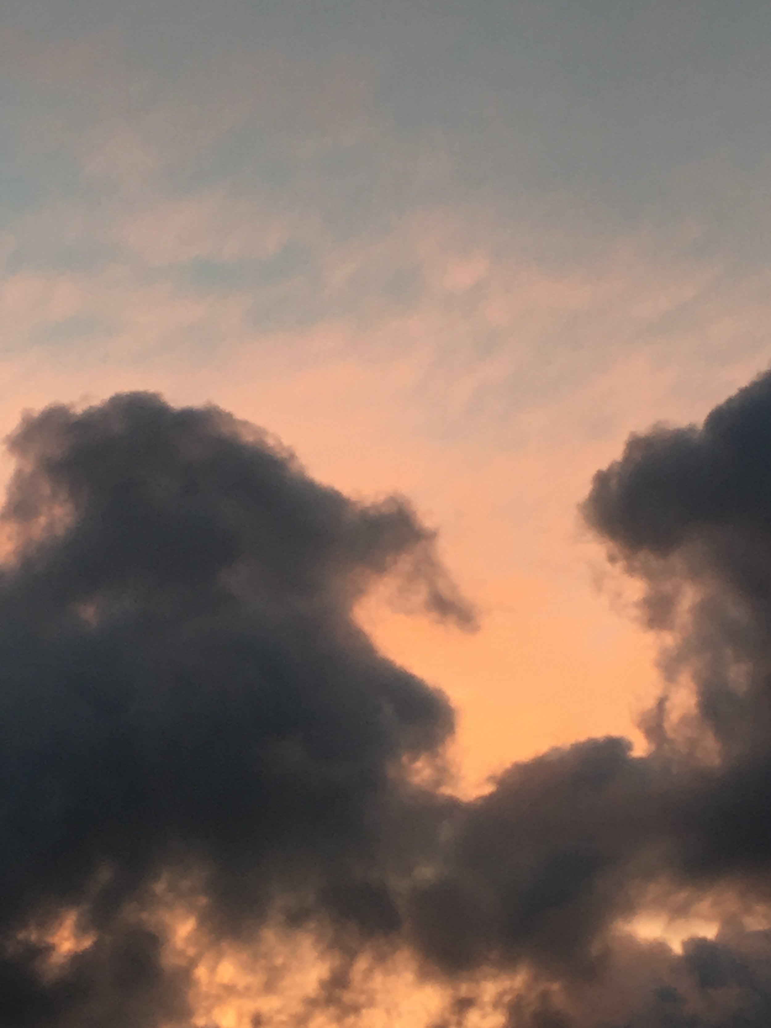 orangey pink morning sky with clouds