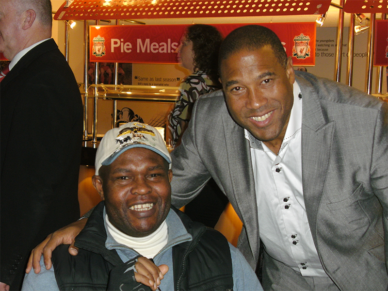 """Ayo Falana (Co-Volunteer Founder & Global Ambassador – LSFH/MAPFest.org) and John Barnes ( A LFC Legend) introducing """"LEADING SUPPORT FOR HUMANITY"""" (LSFH) at a LFC Charity Event."""