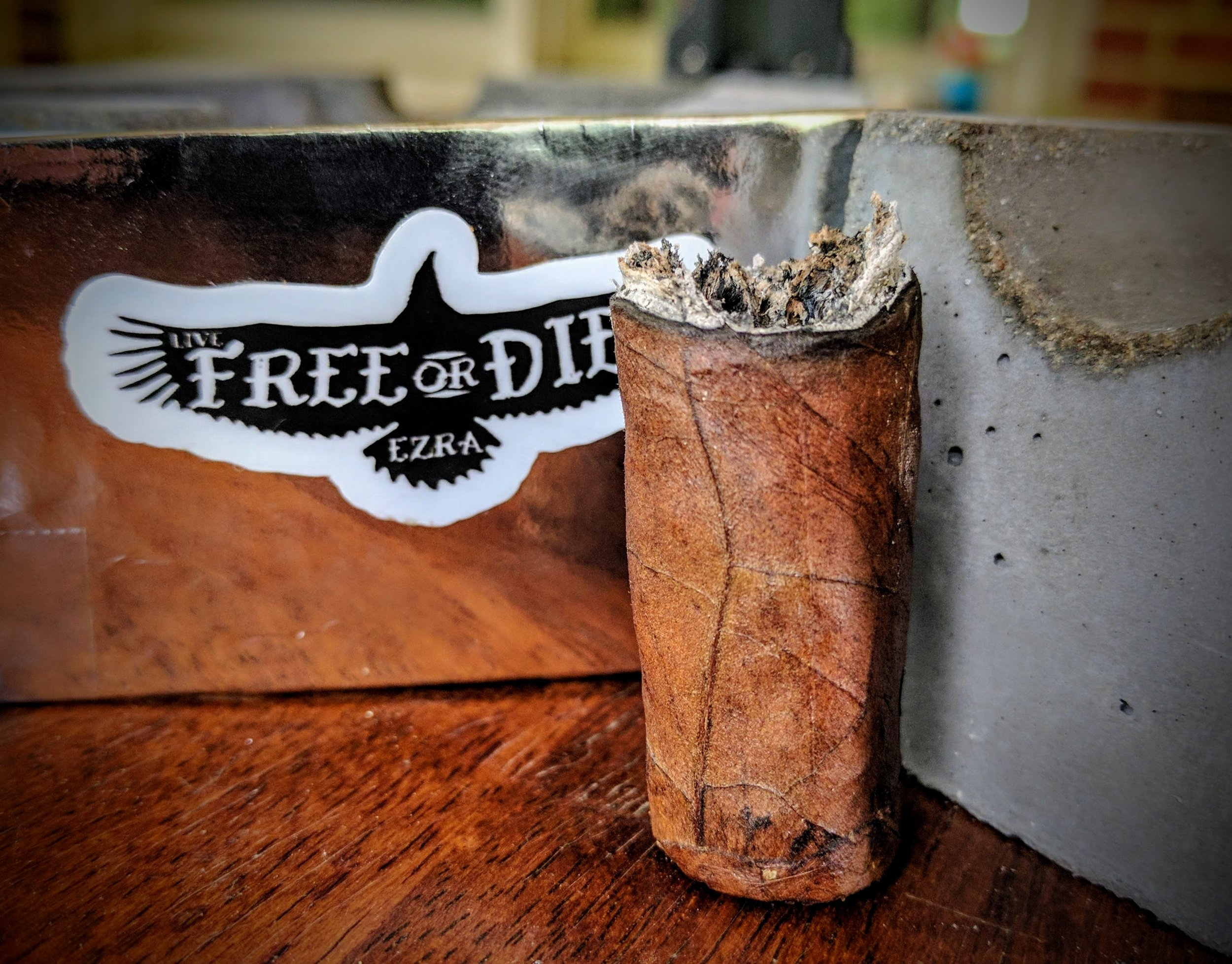 great cigar, needs more ... something.                                     8.5  /  10.0  - The Live Free or Die is meticulously made and starts out like a top-10, luxury cigar should - smooth, subtly complex flavors with a perfect draw and burn. By the time the final third hits, the flavors haven't really departed enough from that initial taste and the burn has started to become an issue. Just a little more from the tail-end of this cigar would've launched it into a different class - it would be a favorite for sure. I could've pardoned some burn issues if the flavors were out-of-this-world but sadly, they just were not. Ezra Zion promotes this as a celebratory stogie and at $12ish a stick, it warrants that class - but the flavors won't prove worthy of that status.