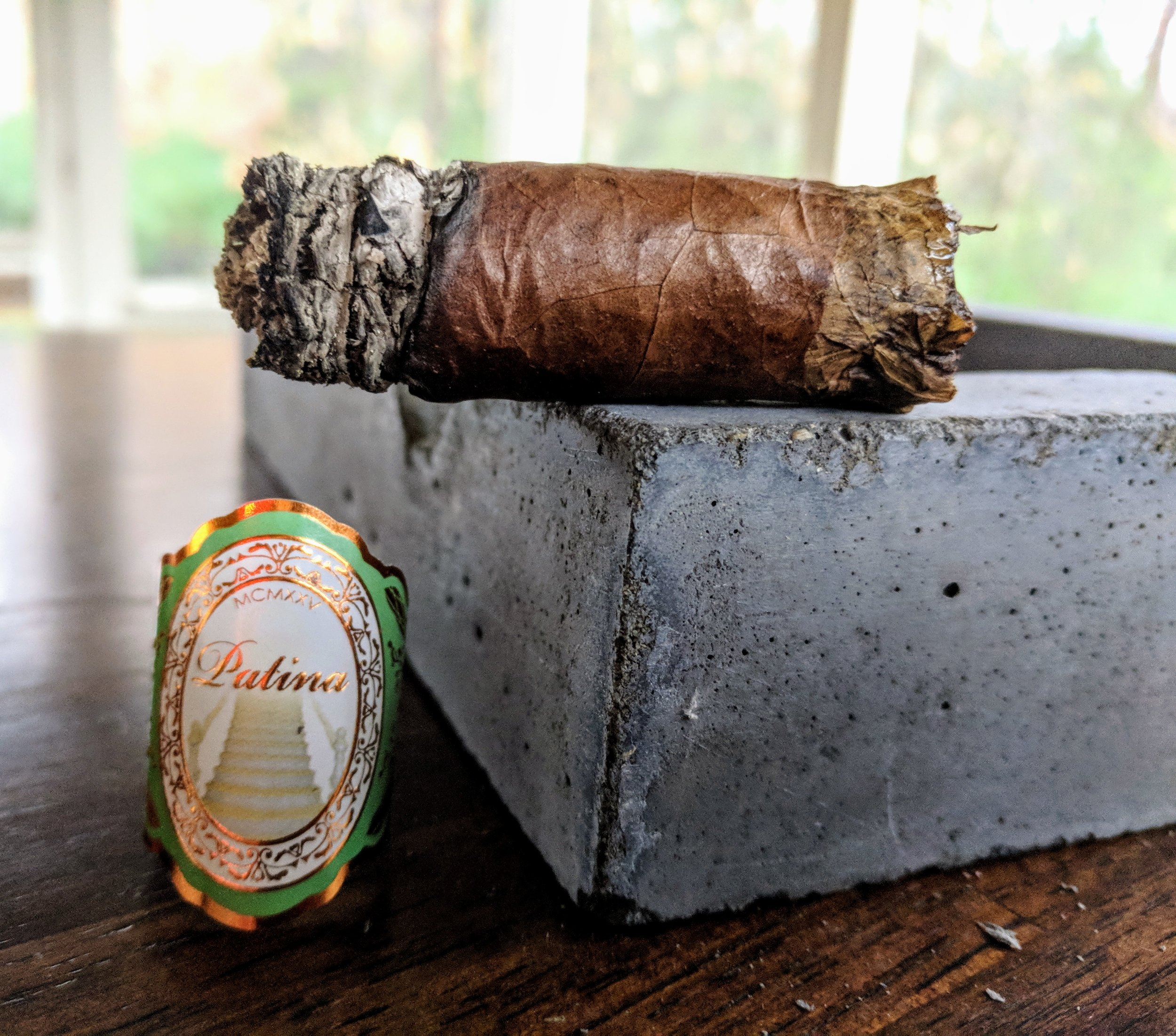 A nice patina.               8.1 / 10.0 - Patina's Habano blend was my introduction to the brand and it certainly did not fall short. The toro started flavorful enough and always melded together to create a complex and perfectly balanced cigar. It had some expected cedar and spice but the cream, vanilla and orange zest were a welcome addition and really shined at the end.For the price, I feel like the Patina Habano really delivers and has earned my recommendation. I'm looking forward to seeing what the other blends and vitolas have to offer!