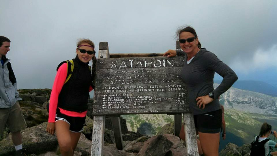 Angela and Kelsey at the end of their journey at the top of Mount Katahdin, ME.