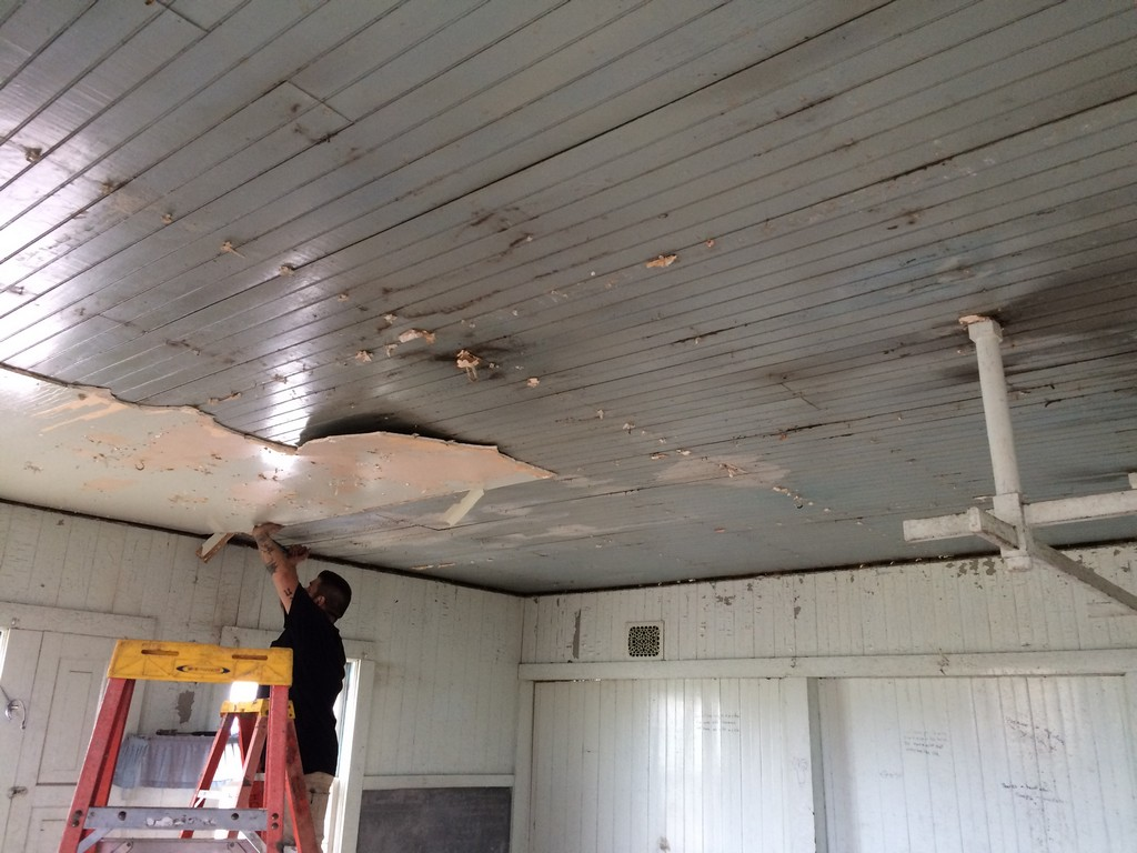 Original ceiling is exposed as drywall in removed.