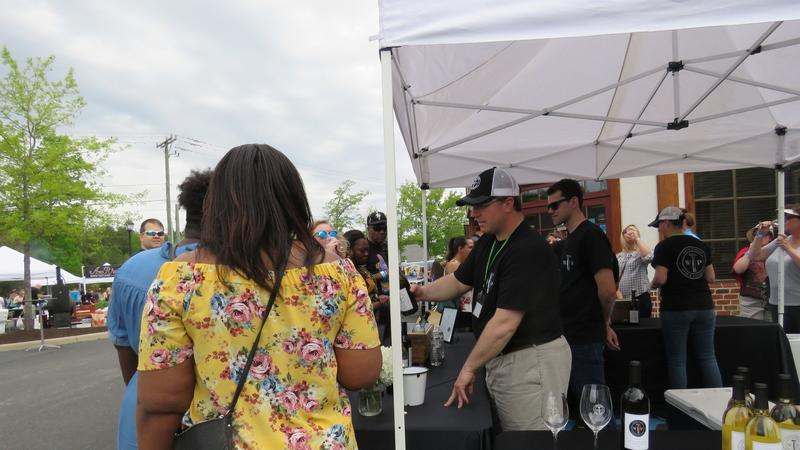 Del. Chris Peace serving festival goers wine from his family operated winery White Plains Farm and Vineyard (Ashley Luck, Tidewater Review)