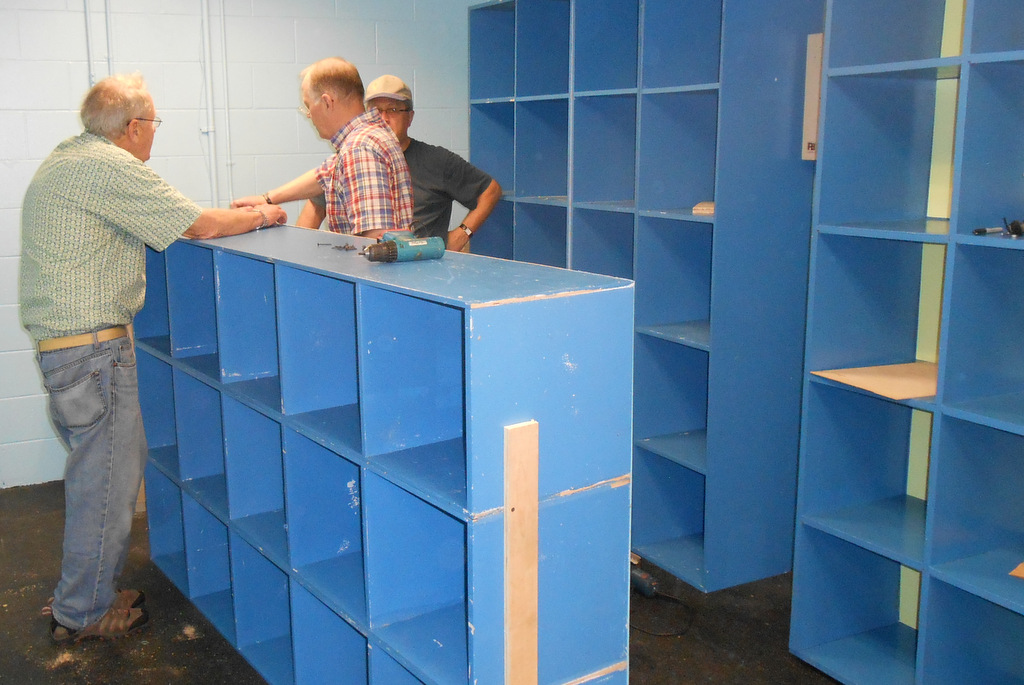 The Boys and Girls Club of Assabet Valley gets new cubbies with the help of St. John carpenters.