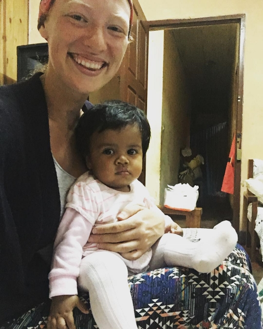 Bryn holding one of the local babies! For more photos visit her photo gallery at  https://www.stjohnsudburyma.org/bryn-in-madagascar