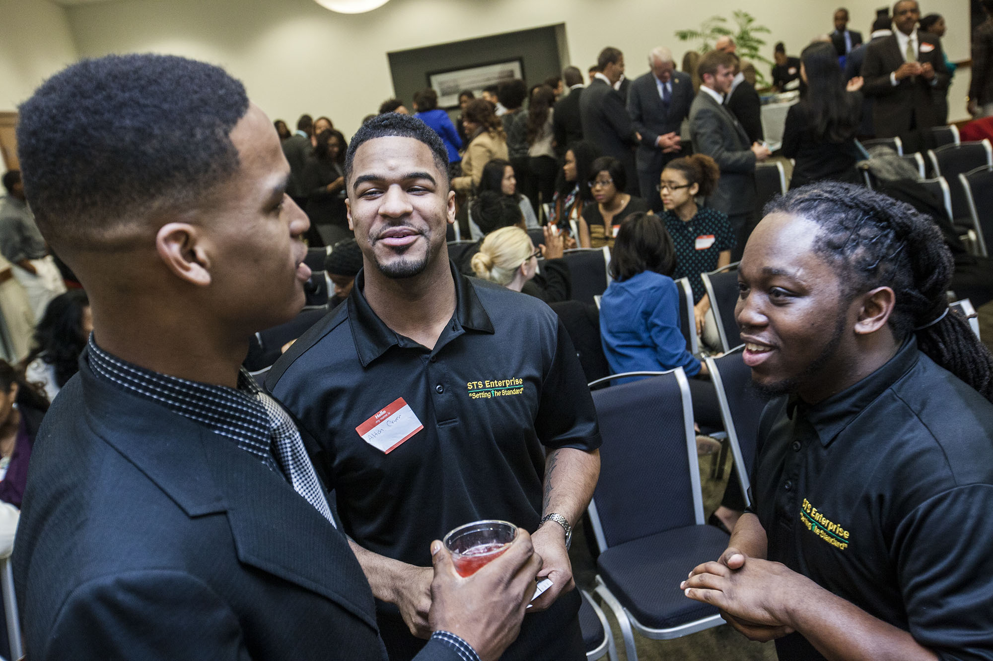 """The crowd mingles while at the """"Bringing out the Leaders"""" event at the University of Memphis on Thursday night. The event is part of Alton Cryer (far left) and Jeremy Calhoun's (not pictured) efforts to help college students network with local government and business officials. (Andrea Morales/Special to the Commercial Appeal)"""
