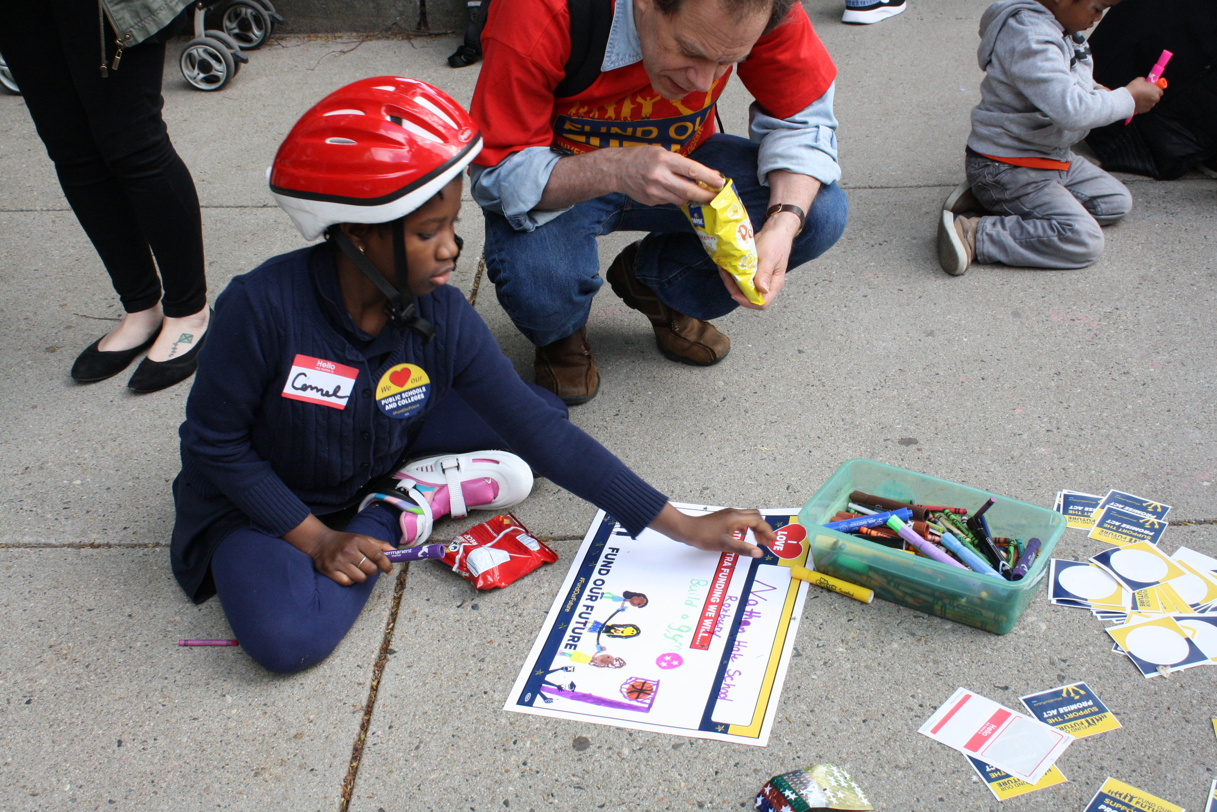 Student at May 16 Playdate Protest to support #FundOurFuture