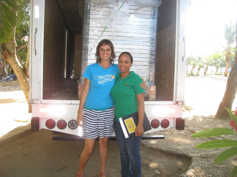 Raquel with Amanda and donated solar panels arrival.jpg