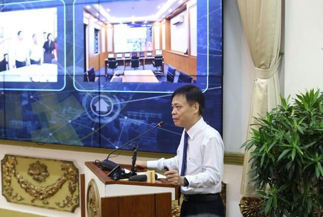 Phó giám đốc Sở TT&TT Lê Quốc Cường báo cáo tại hội nghị