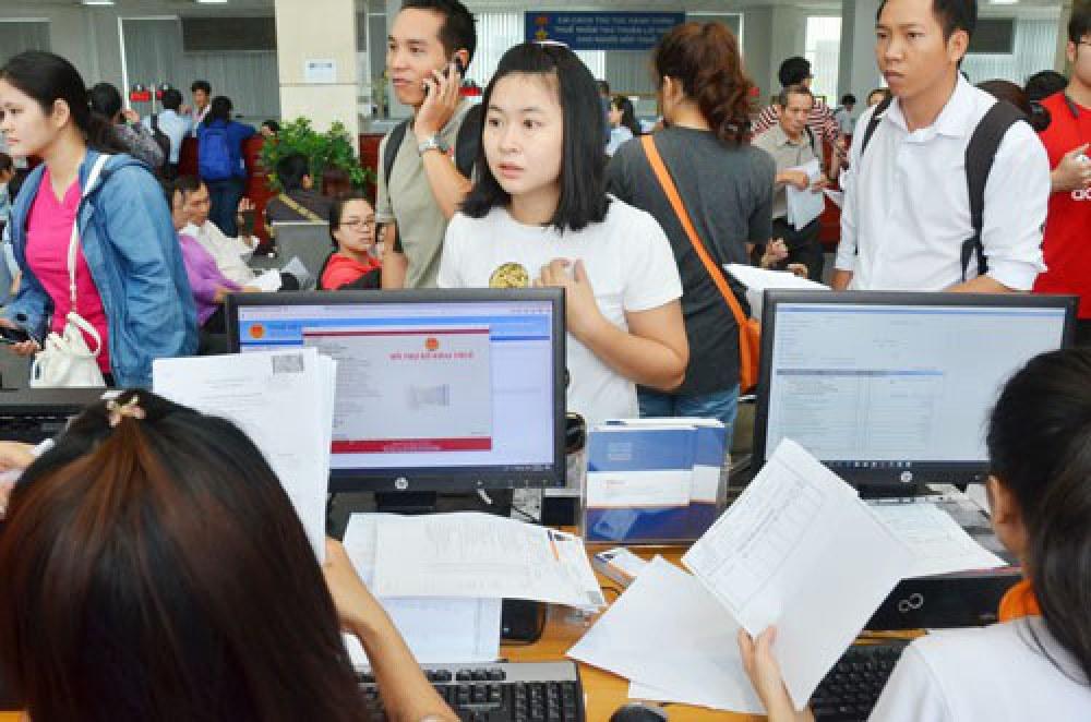 Cục Thuế TP HCM triển khai Ứng dụng hỗ trợ người dân khai thuế điện tử. Ảnh: TẤN THẠNH