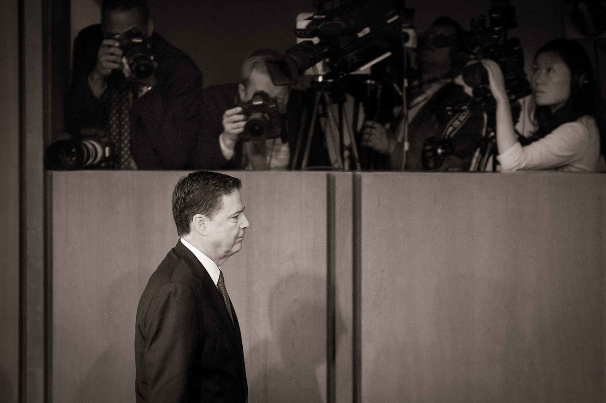 Former FBI director James Comey walks past the media and cameras after his testimony at the Senate Intelligence Committee, where he said the White House lied about why he was fired and that he leaked his own memos to the press on his interactions with President Donald Trump, in Washington, D.C., on June 8, 2017.