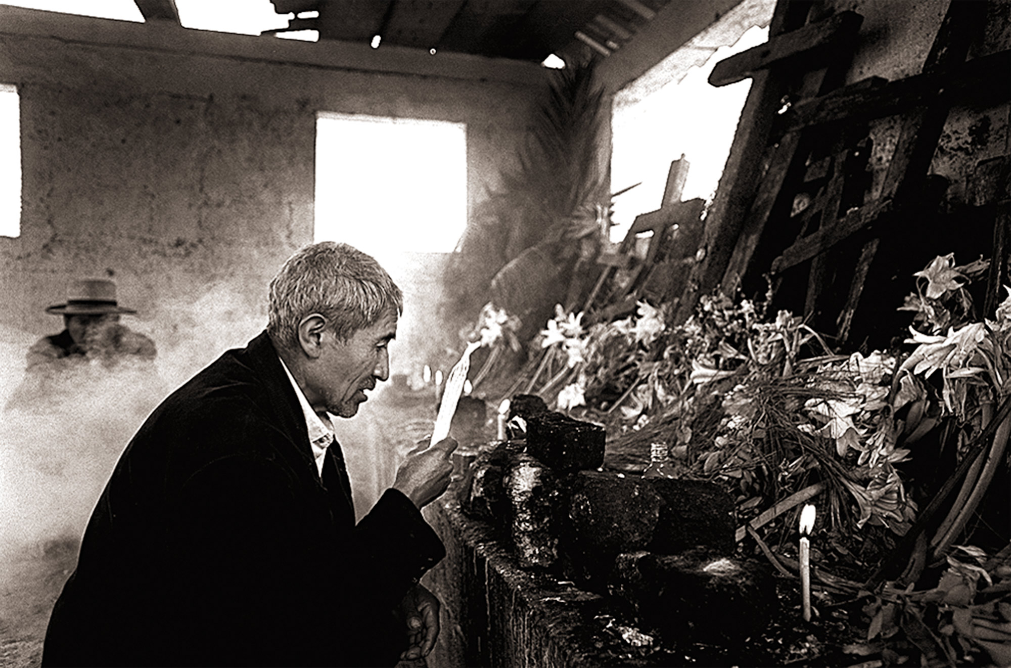 Mayan priests Pedro Corio and Tomas Brito visit the Cementerio General in Nebaj to perform Mayan rituals for the diseappeared of Guatemala's 36-year civil war.