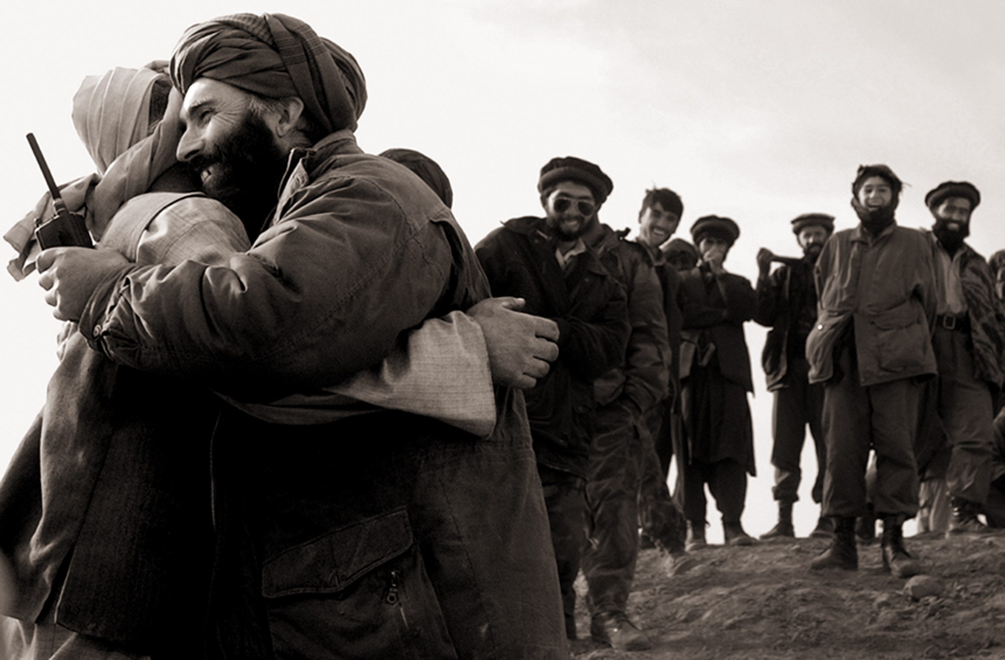 Northern Alliance and Taliban commanders greet each other as old friends after a tense surrender of some 500 Taliban soldiers on the Konduz front lines. Negotiations with the Taliban allowed them to keep their vehicles and arms, as long as they surrendered peacefully.